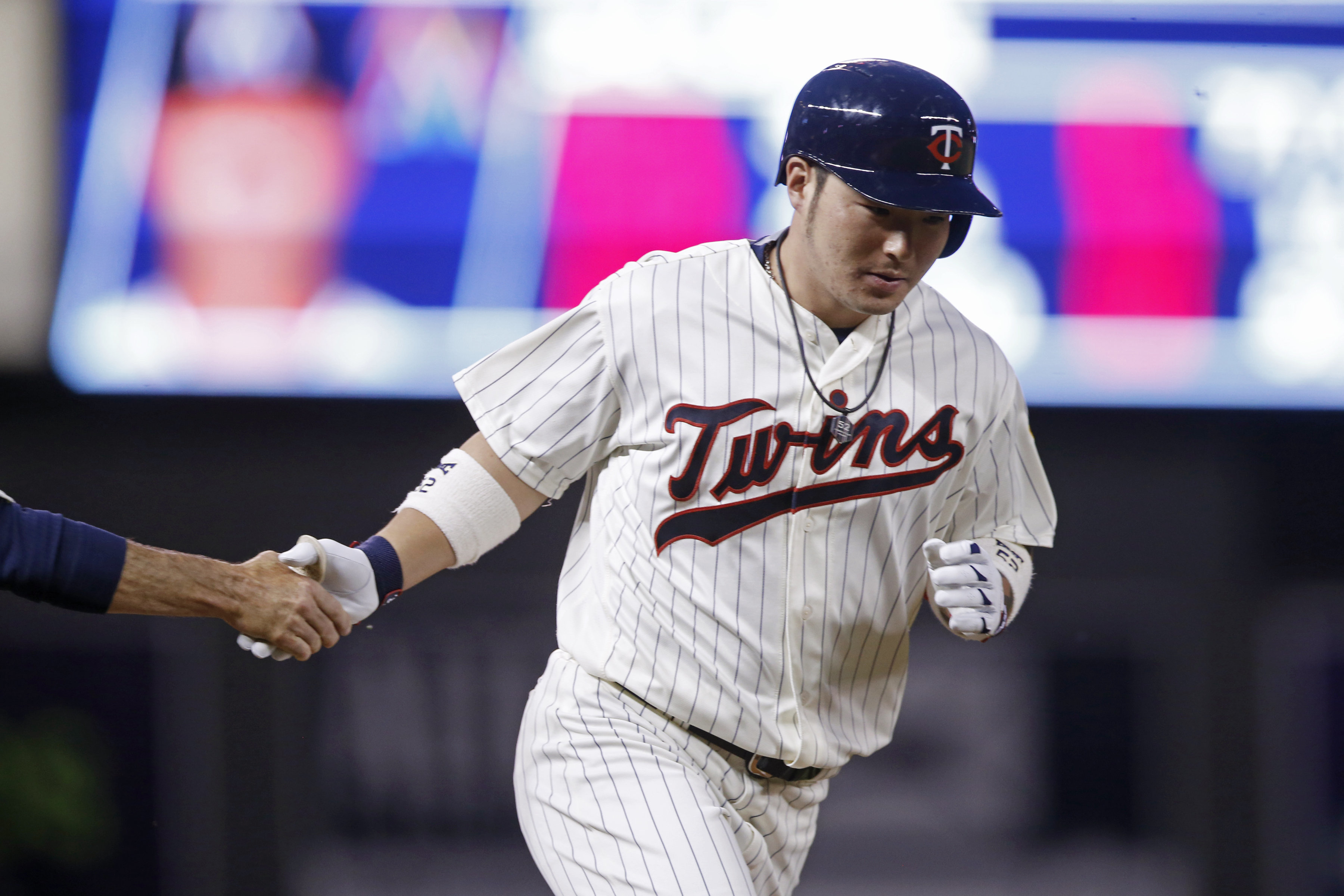Minnesota Twins' Byung Ho Park, of South Korea, rounds the bases on a solo home off Miami Marlins starting Wei-Yin Chen during the sixth inning of a baseball game Wednesday, June 8, 2016, in Minneapolis. (AP Photo/Jim Mone)