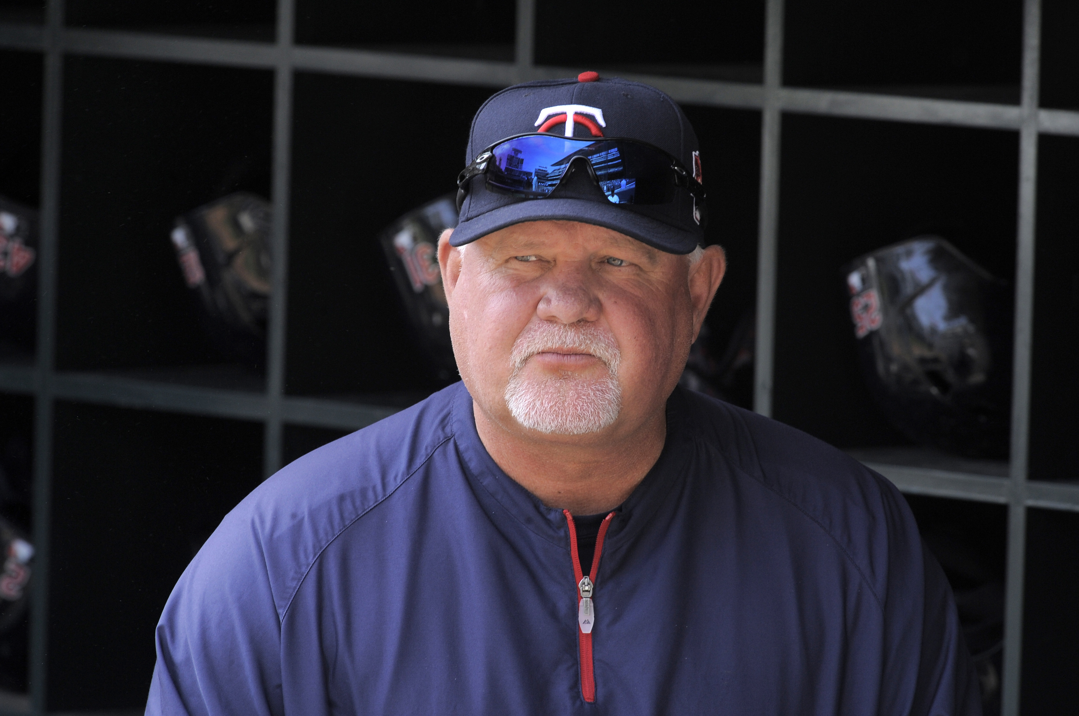 """FILE - In this Wednesday, April 9, 2014 file photo, Minnesota Twins manager Ron Gardenhire watches from the dugout during a baseball game against the Oakland Athletics in Minneapolis. Ron Gardenhire says he would """"love to manage again"""" but that he's not a"""