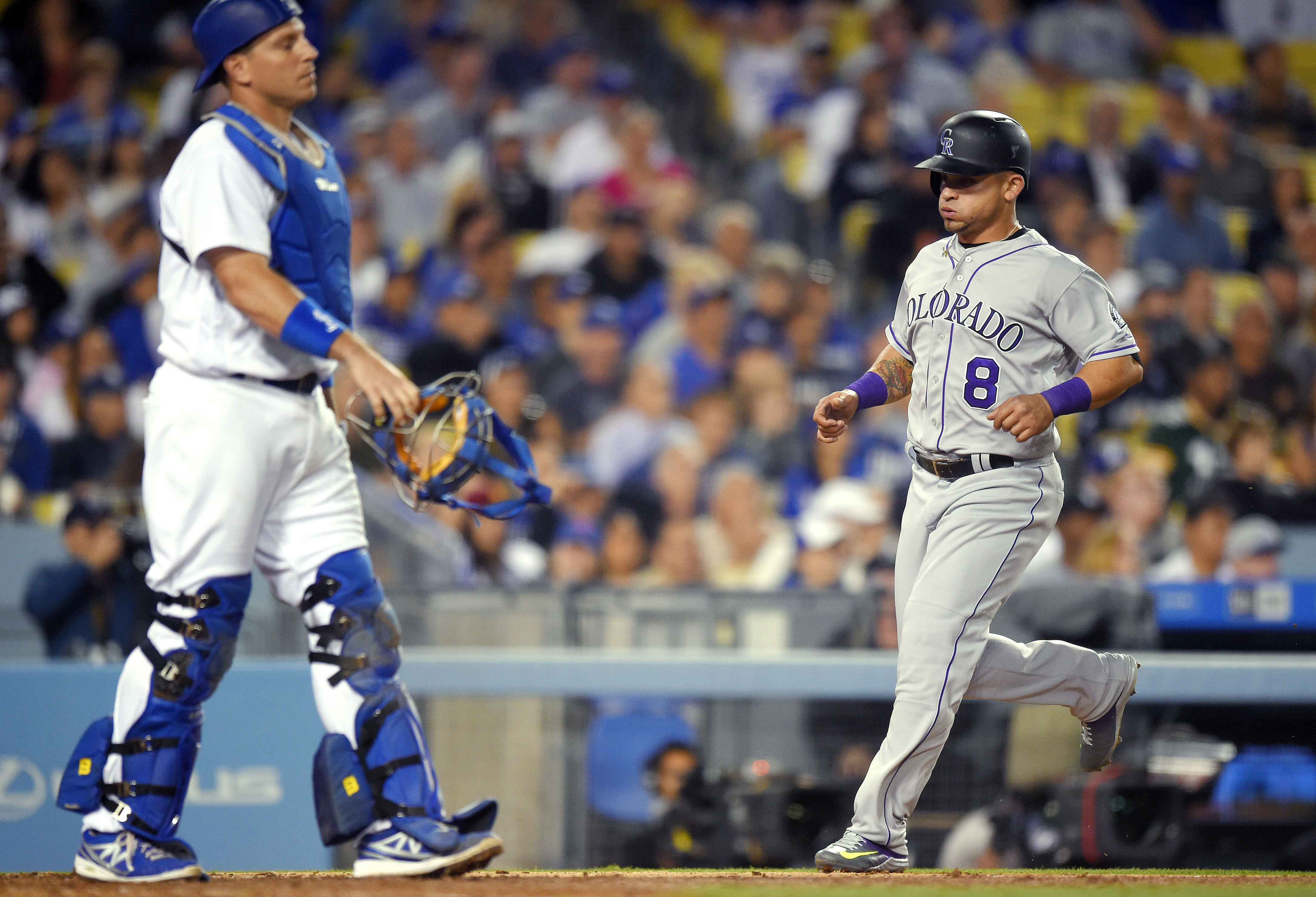 Los Angeles Dodgers' Bob Geren, right, scores on a single by Daniel Descalso as Los Angeles Dodgers catcher A.J. Ellis stands at the plate during the seventh inning of a baseball game, Wednesday, June 8, 2016, in Los Angeles. (AP Photo/Mark J. Terrill)