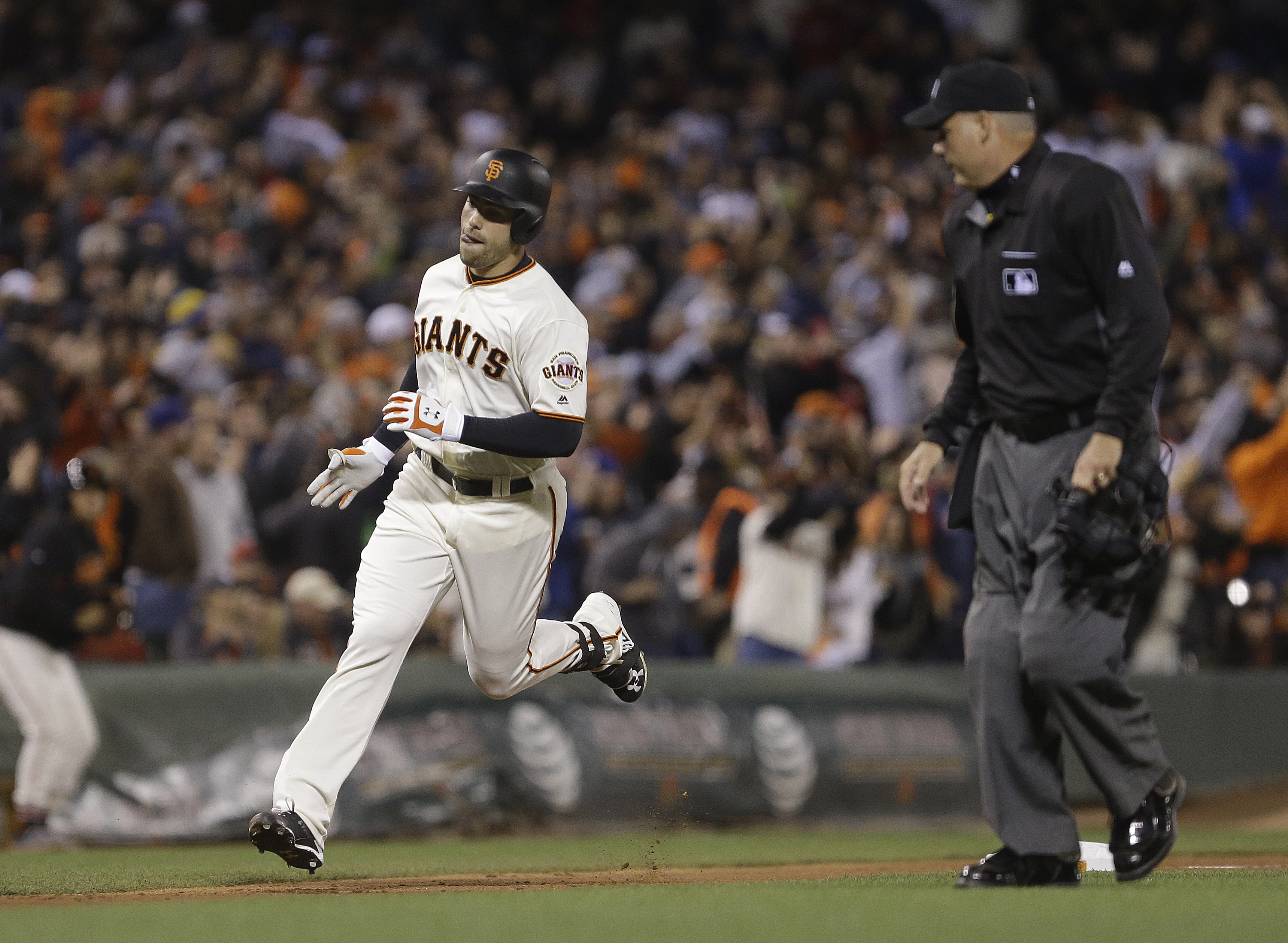 San Francisco Giants' Mac Williamson, left, runs the bases after hitting a home run against the Boston Red Sox during the eighth inning of a baseball game Wednesday, June 8, 2016, in San Francisco. (AP Photo/Ben Margot)
