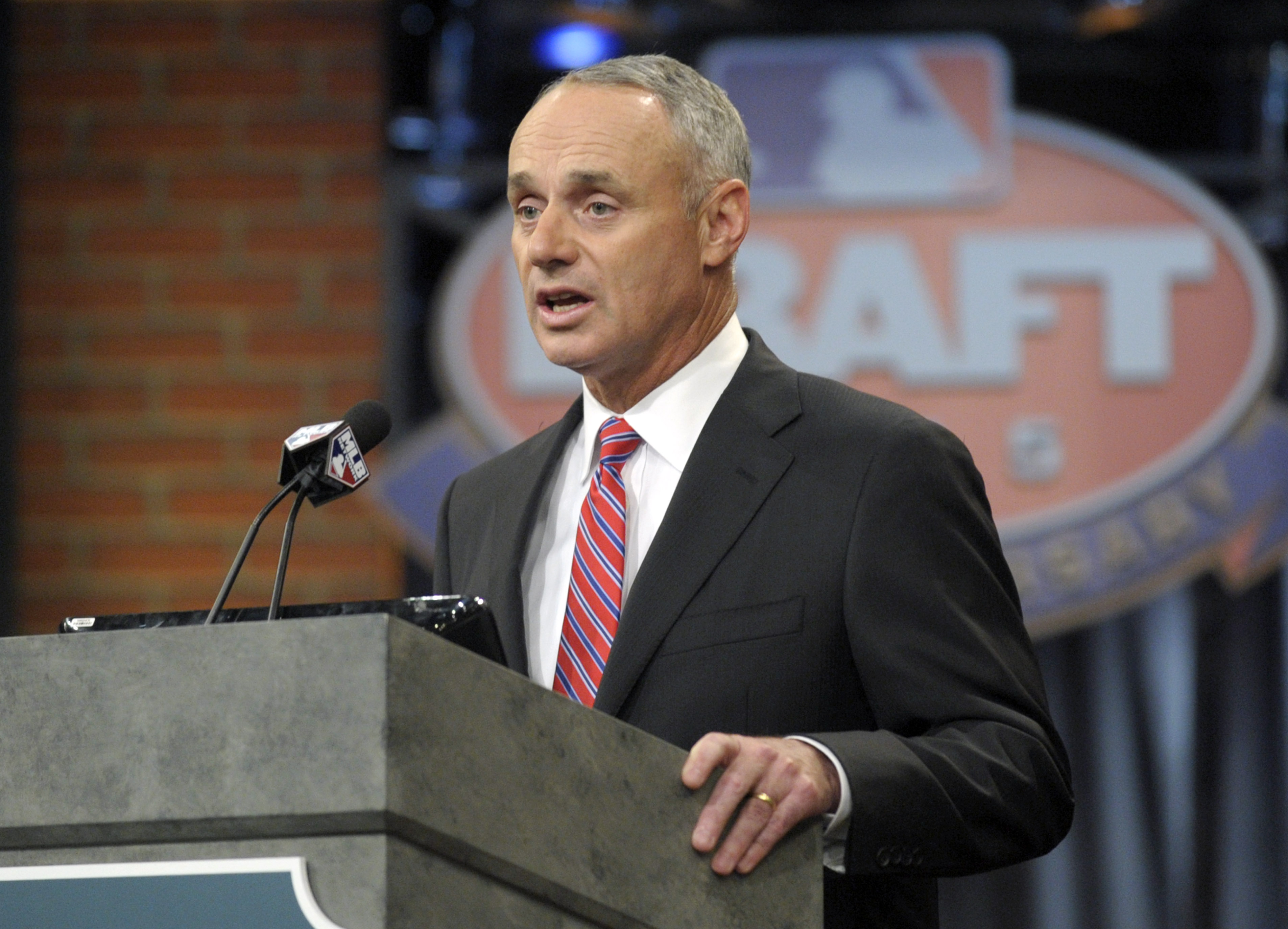 Commissioner of Major League Baseball Rob Manfred announces the selections at the 2015 MLB baseball draft Monday, June 8, 2015, in Secaucus, N.J. (AP Photo/Bill Kostroun)