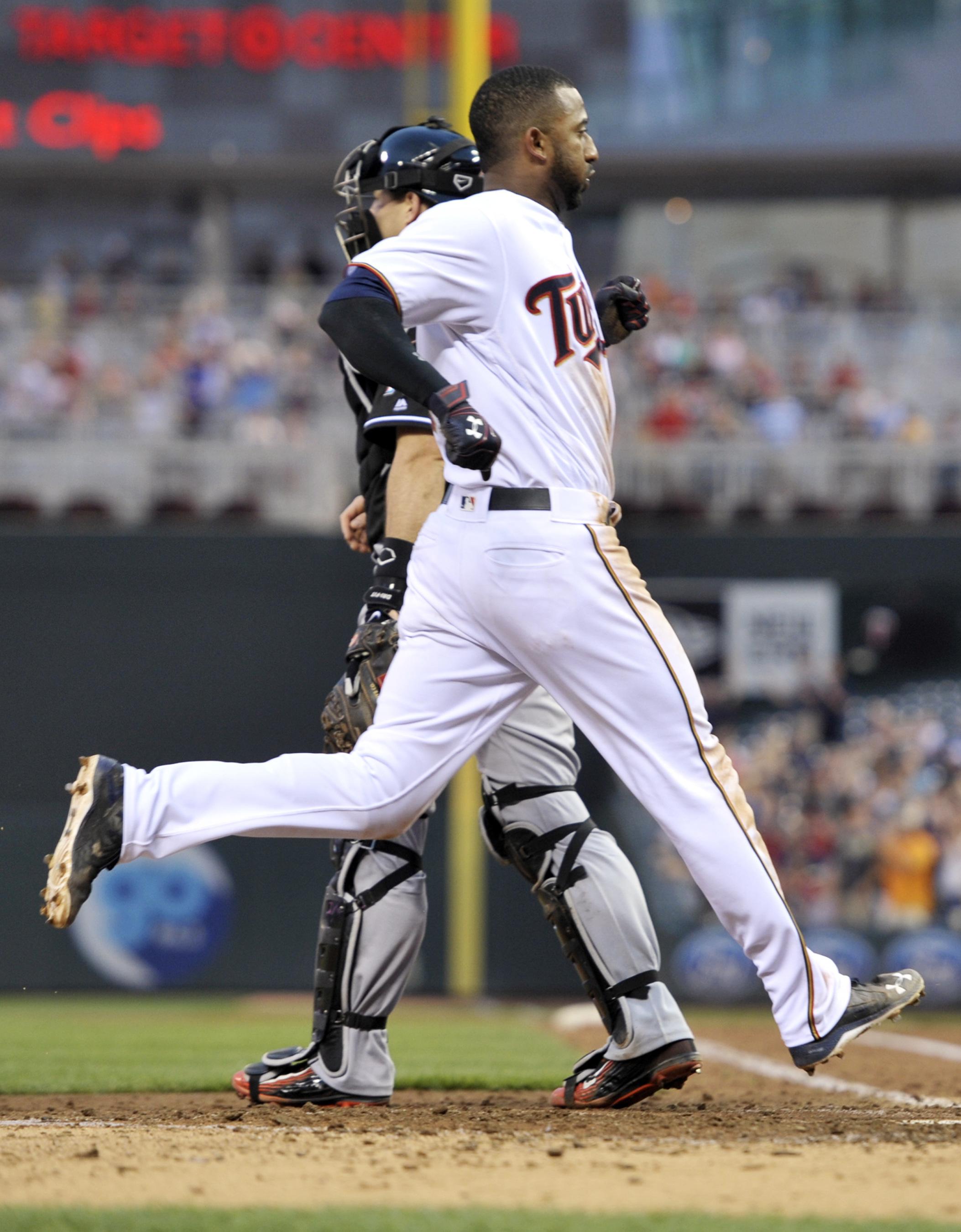 Minnesota Twins' Eduardo Nunez scores during the sixth inning of a baseball game against the Miami Marlins on Thursday, June 9, 2016, in Minneapolis. (AP Photo/Jim Mone)