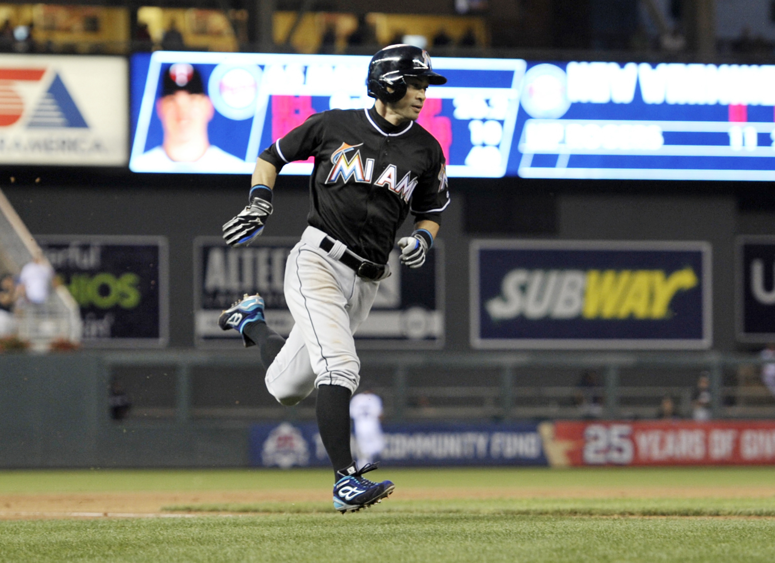 Miami Marlins' Ichiro Suzuki races home as he scores on a hit by Martin Prado off Minnesota Twins pitcher Trevor May during the seventh inning of a baseball game Thursday, June 9, 2016, in Minneapolis. (AP Photo/Jim Mone)