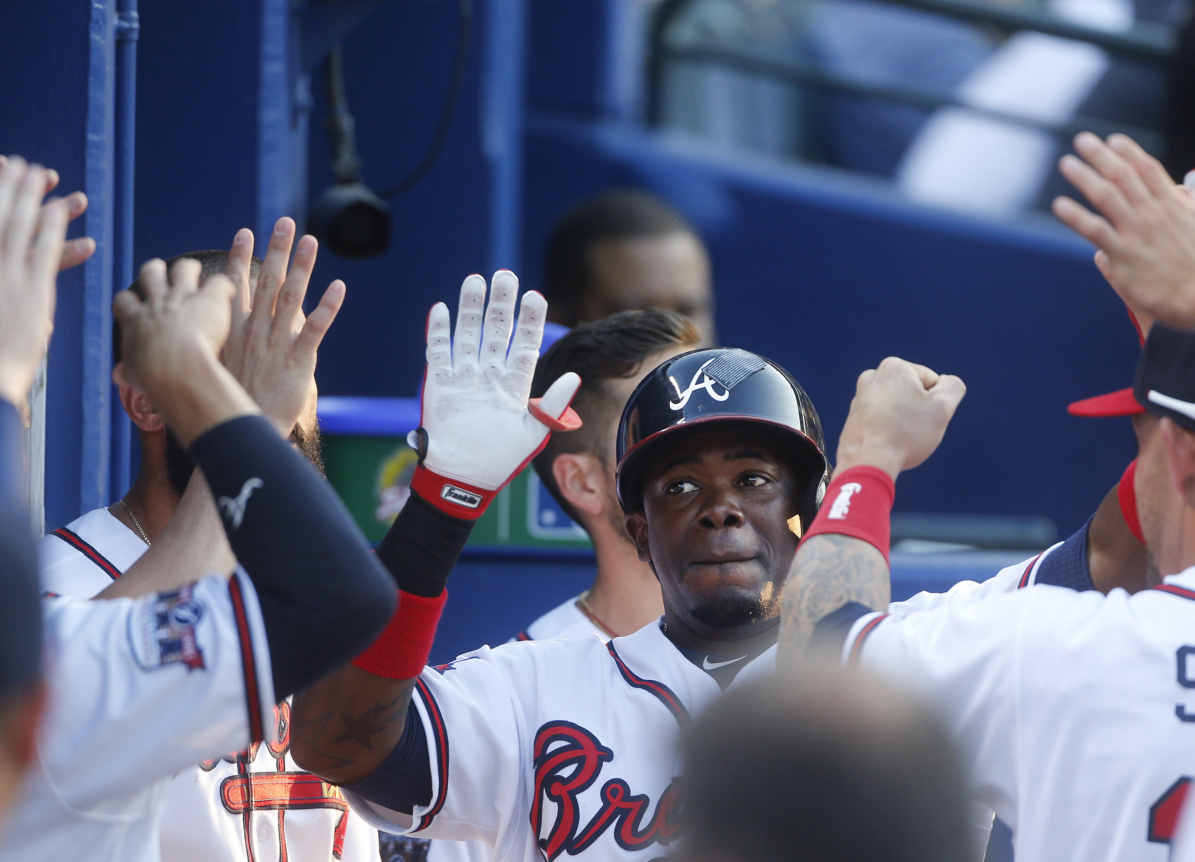 Atlanta Braves' Adonis Garcia celebrates with his teammates in the dugout after hitting a home run during the second inning of a baseball game against the Chicago Cubs on Friday, June 10, 2016, in Atlanta. (AP Photo/John Bazemore)
