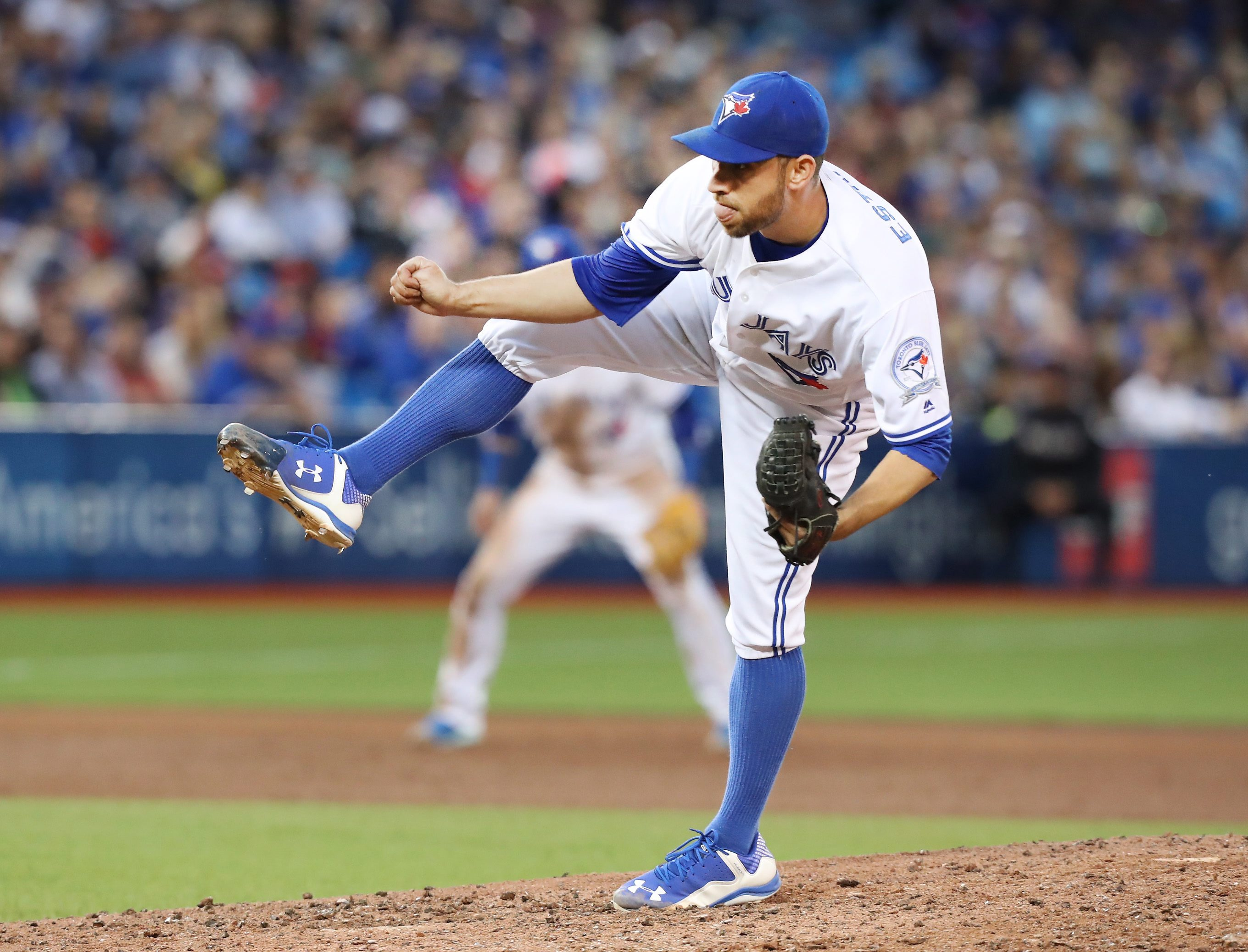 Toronto Blue Jays starting pitcher Marco Estrada throws against the Baltimore Orioles during the sixth inning of a baseball game, Friday, June 10, 2016, in Toronto. (Fred Thornhill/The Canadian Press via AP) MANDATORY CREDIT
