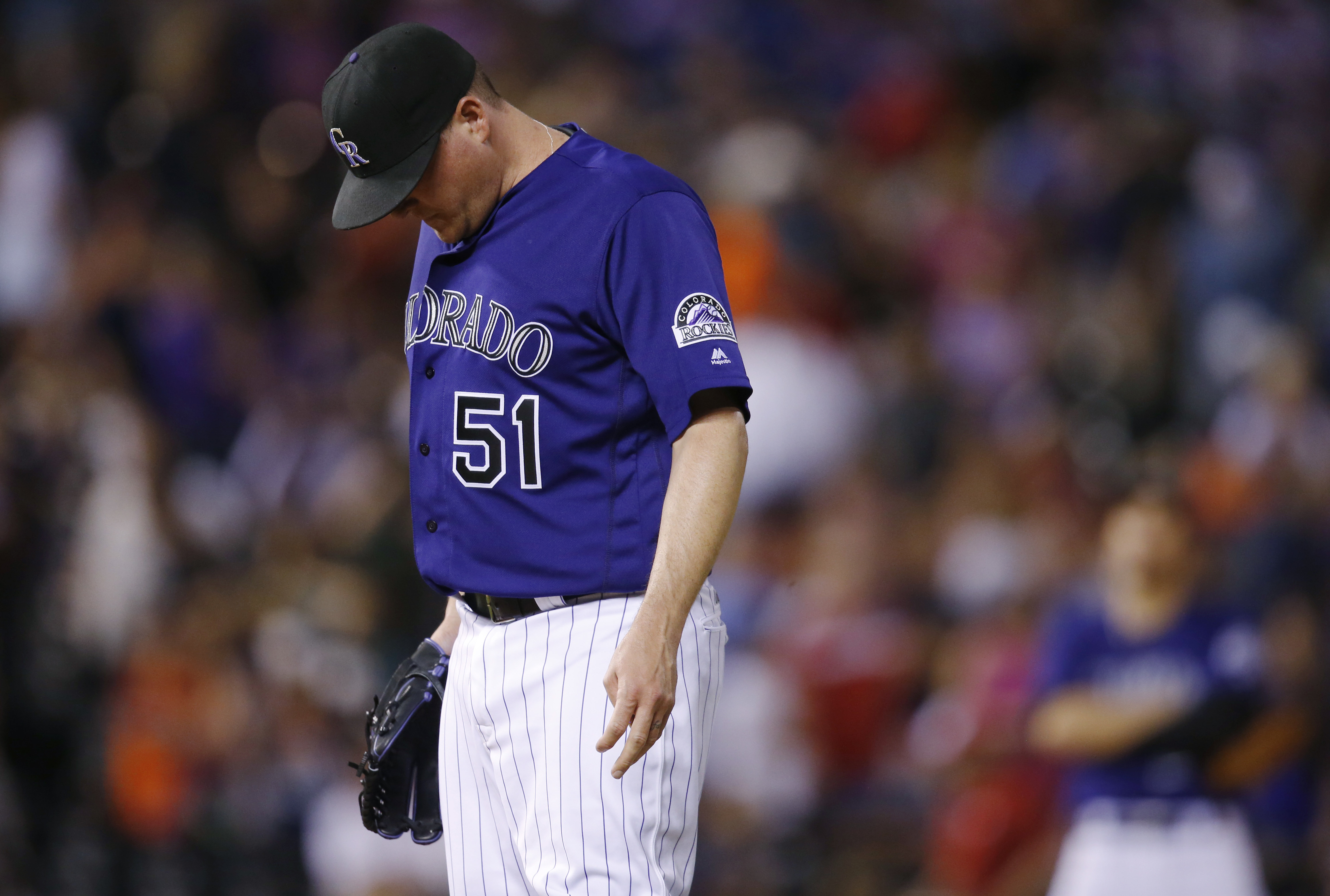 Colorado Rockies relief pitcher Jake McGee reacts after giving up a three-run home run to San Diego Padres' Wil Myers during the ninth inning of a baseball game Friday, June 10, 2016, in Denver. San Diego won 7-5. (AP Photo/David Zalubowski)