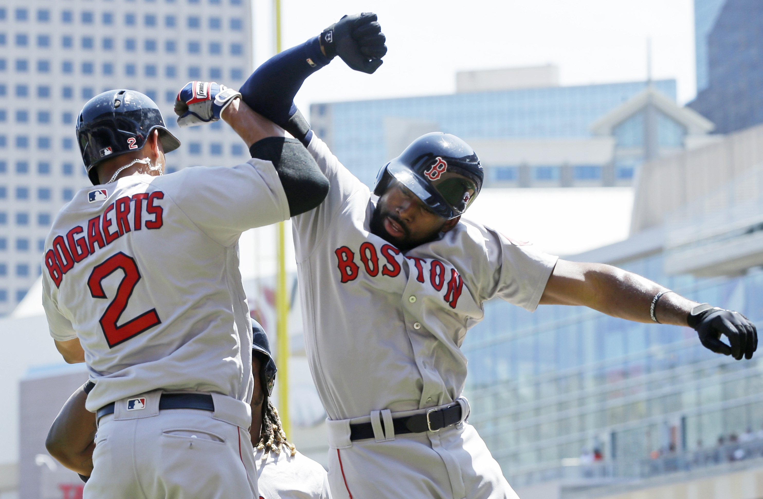 Boston Red Sox's Jackie Bradley Jr., right, celebrates with Xander Bogaerts after Bradley's three-run home run off Minnesota Twins pitcher Kyle Gibson in the first inning of a baseball game Saturday, June 11, 2016, in Minneapolis. (AP Photo/Jim Mone)