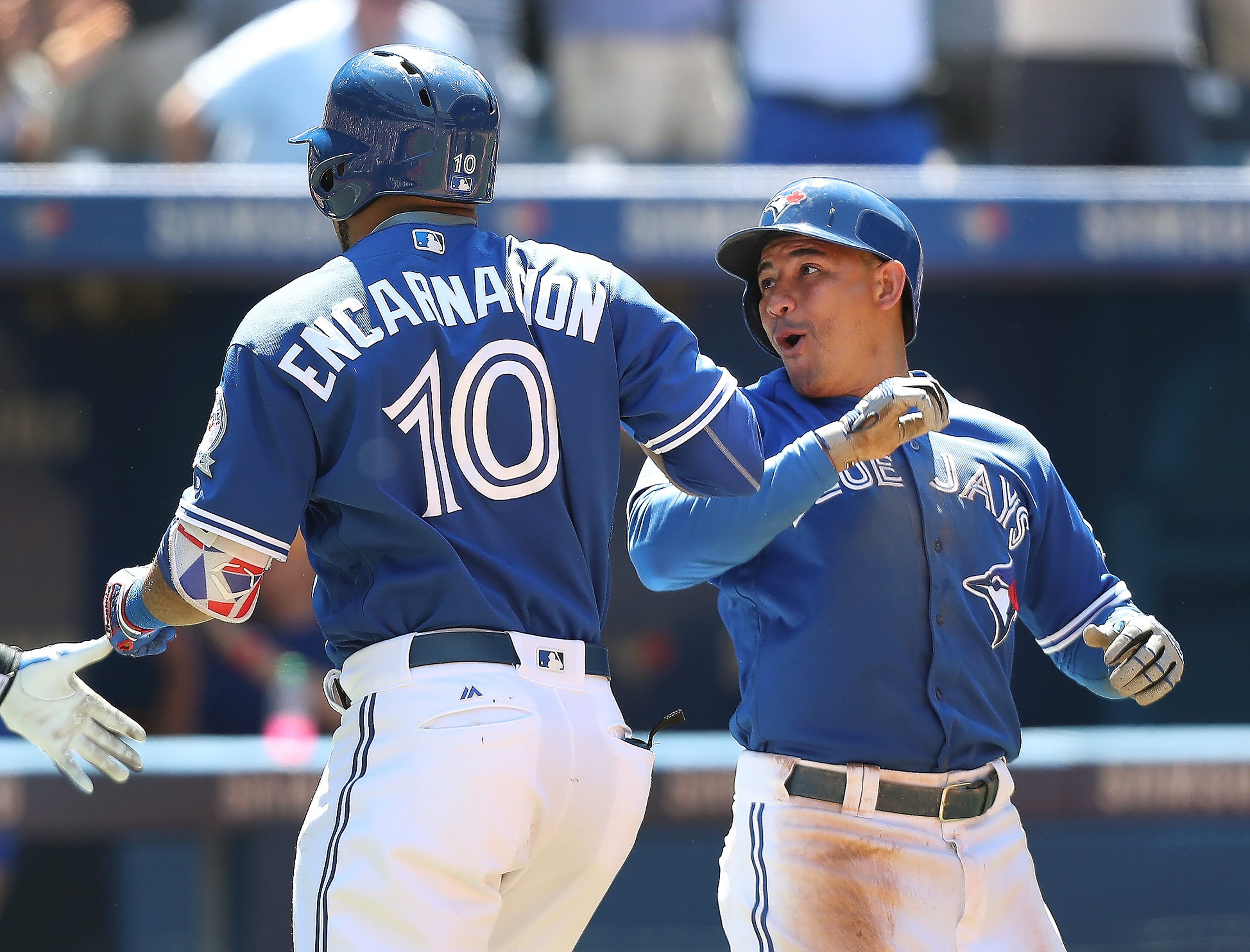 Toronto Blue Jays' Edwin Encarnacion, left, is greeted by teammate Ezequiel Carrera after hitting a three-run home run in the sixth inning of a baseball game against the Baltimore Orioles in Toronto, Saturday, June 11, 2016. (Fred Thornhill/The Canadian P