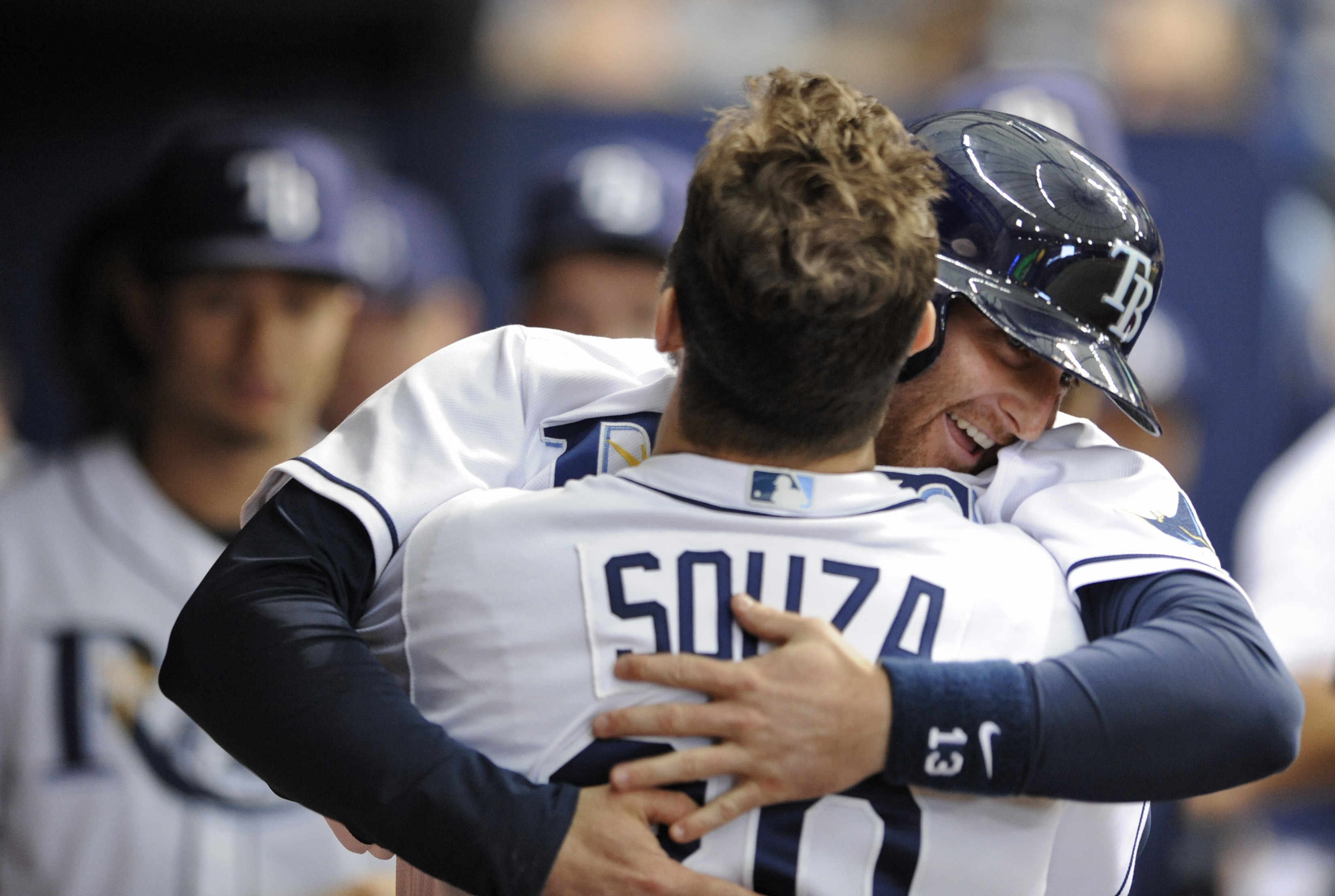Tampa Bay Rays' Steven Souza Jr., center, congratulates Brad Miller, right, in the dugout after his solo home run off Houston Astros starter Mike Fiers during the third inning of a baseball game, Saturday, June 11, 2016, in St. Petersburg, Fla. (AP Photo/