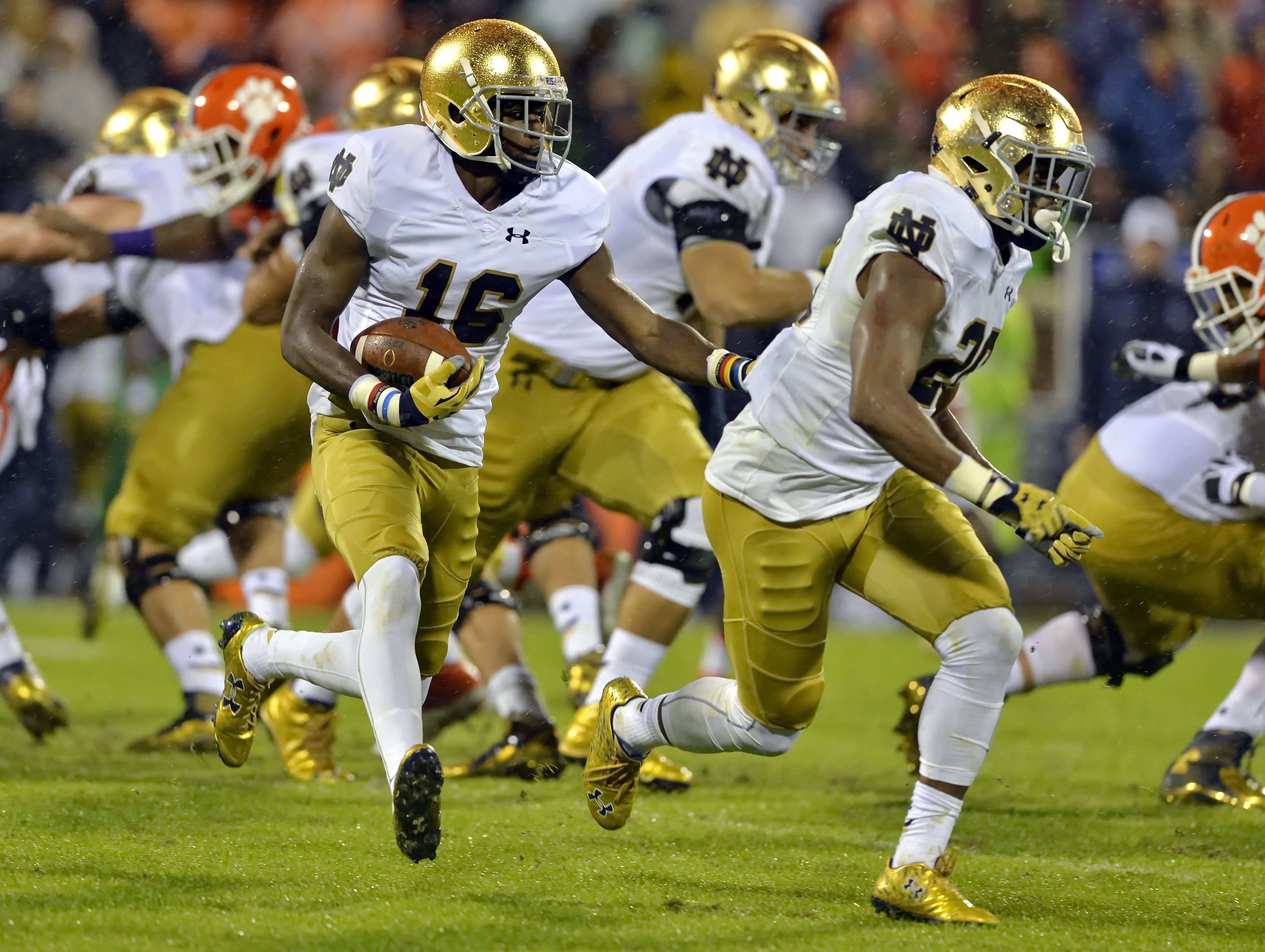 FILE - In this Oct. 3, 2015, file photo, Notre Dame's Torii Hunter Jr. (16) with blocking help from C. J. Prosise, rushes out of the backfield during the first half of an NCAA college football game against Clemson  in Clemson,  S.C.  The Los Angeles Angel