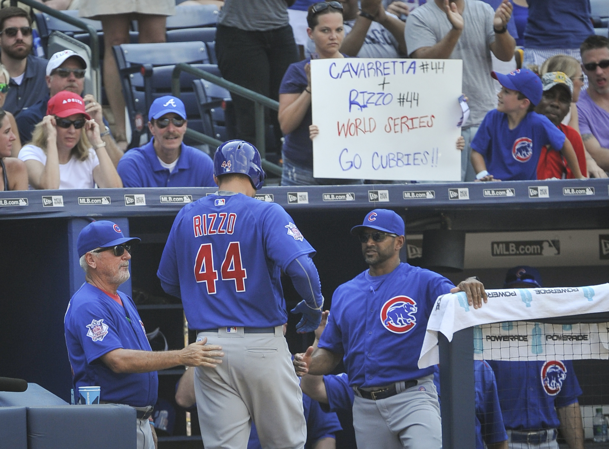 Chicago Cubs' Anthony Rizzo (44) is congratulated as he enters the dugout by manager Joe Maddon, left, after hitting a homerun to right center field against the Atlanta Braves during the fourth inning of a baseball game, Saturday, June, 11, 2016, in Atlan