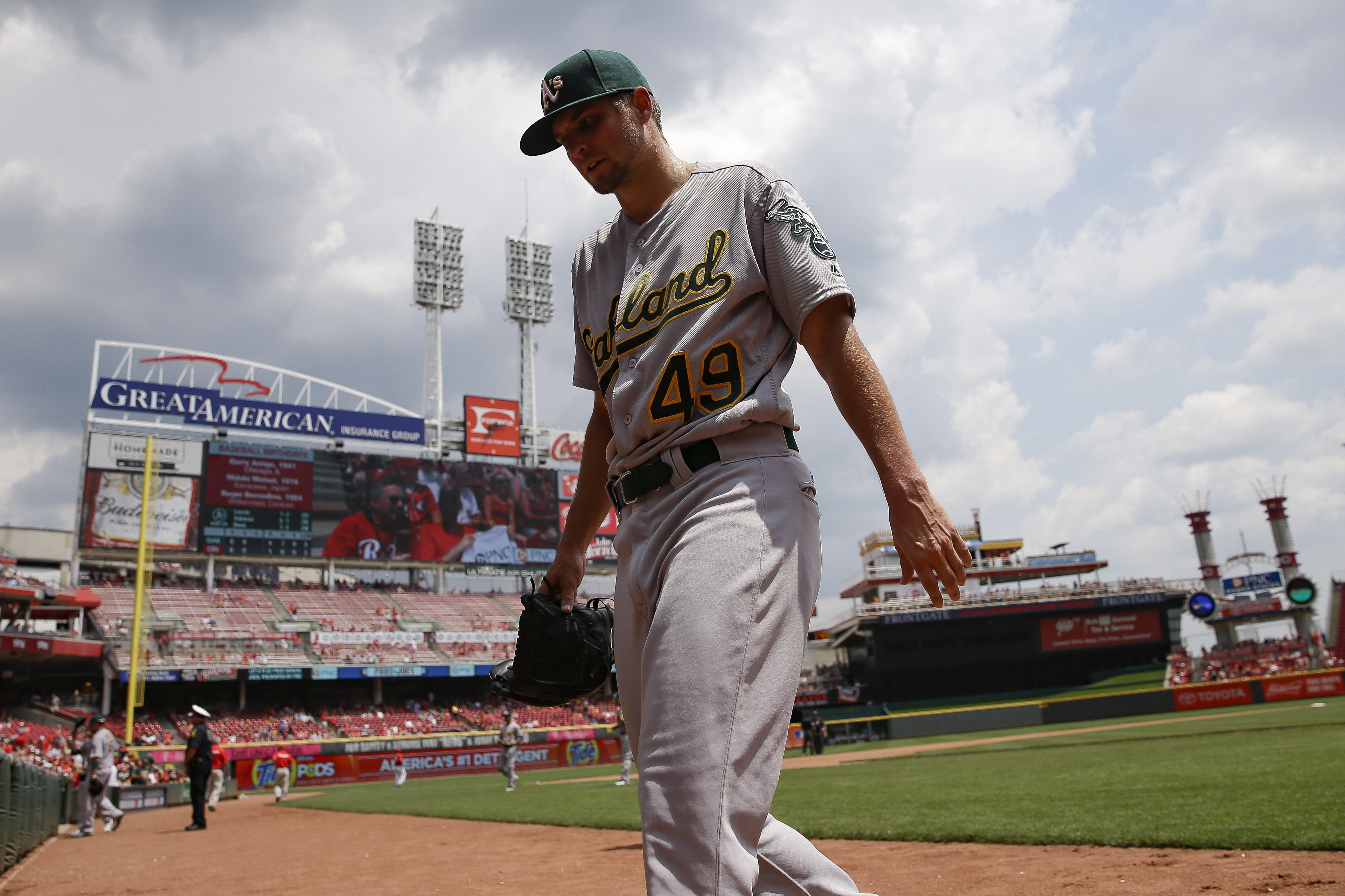 Oakland Athletics starting pitcher Kendall Graveman walks off the field after closing the fourth inning of a baseball game against the Cincinnati Reds, Sunday, June 12, 2016, in Cincinnati. (AP Photo/John Minchillo)