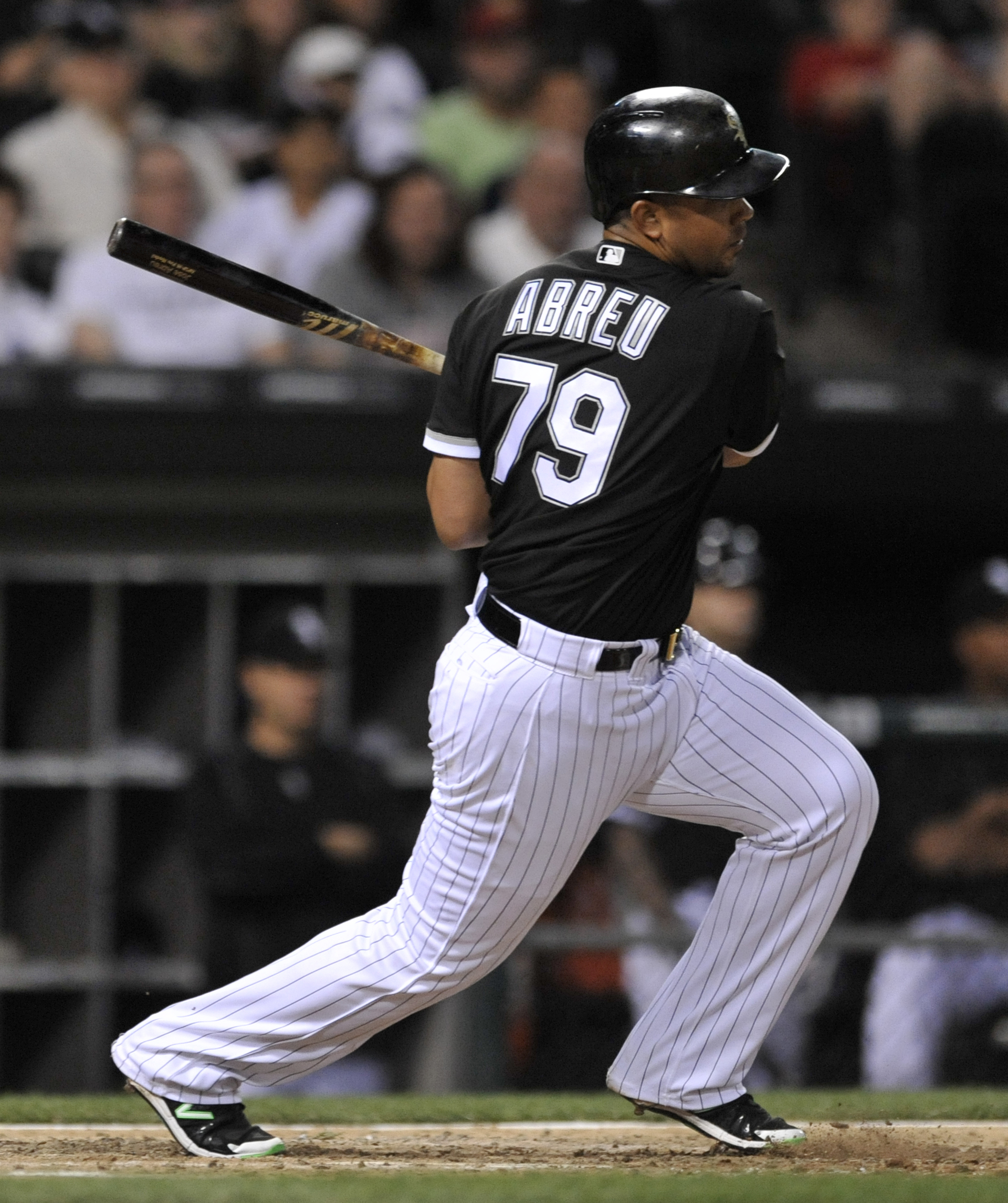 Chicago White Sox's Jose Abreu watches his RBI single during the fifth inning of a baseball game against the Detroit Tigers on Monday, June 13, 2016, in Chicago. (AP Photo/Paul Beaty)