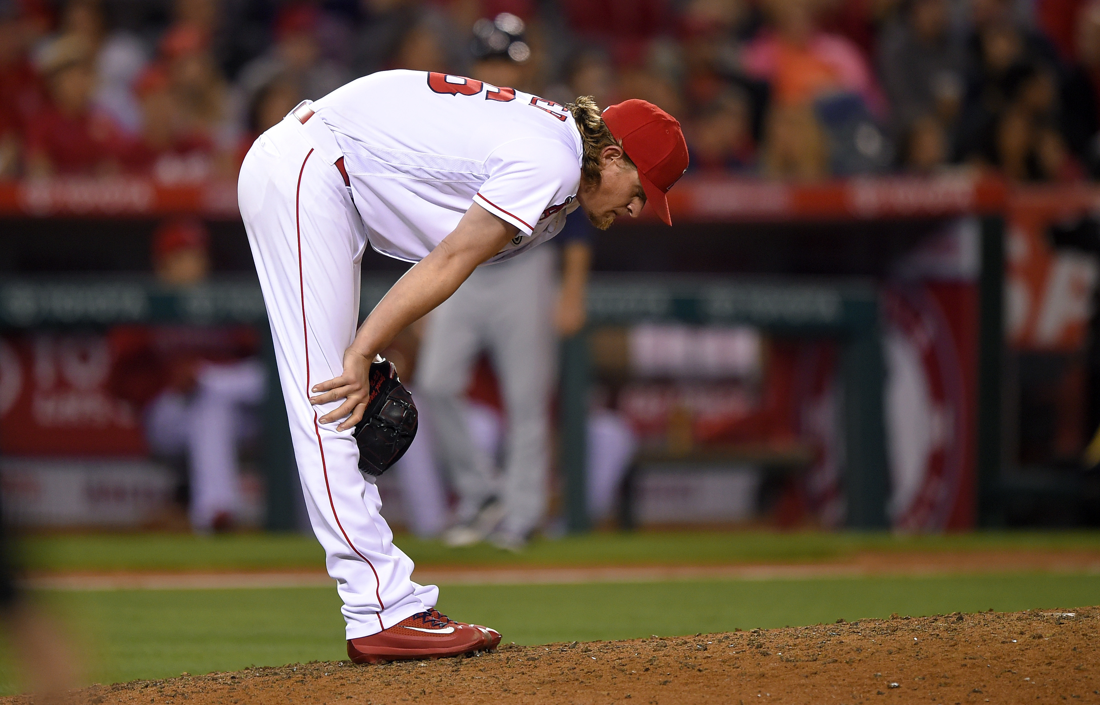 Los Angeles Angels starting pitcher Jered Weaver leans over the mound after giving up a solo home run to Minnesota Twins' Byron Buxton during the sixth inning of a baseball game Monday, June 13, 2016, in Anaheim, Calif. (AP Photo/Mark J. Terrill)