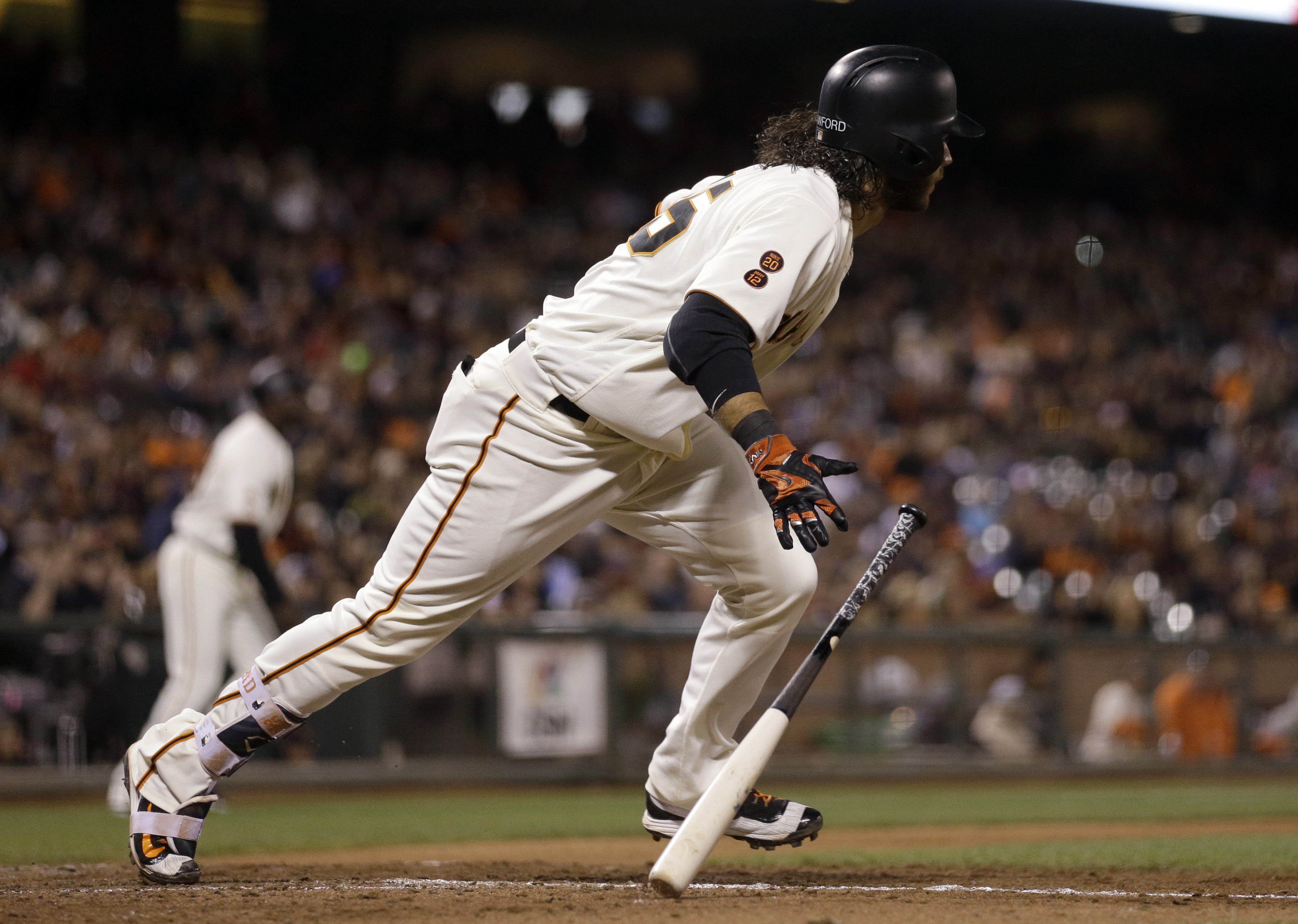 San Francisco Giants' Brandon Crawford runs to first after hitting a two-run single off Milwaukee Brewers' Blaine Boyer during the seventh inning of a baseball game Monday, June 13, 2016, in San Francisco. (AP Photo/Ben Margot)