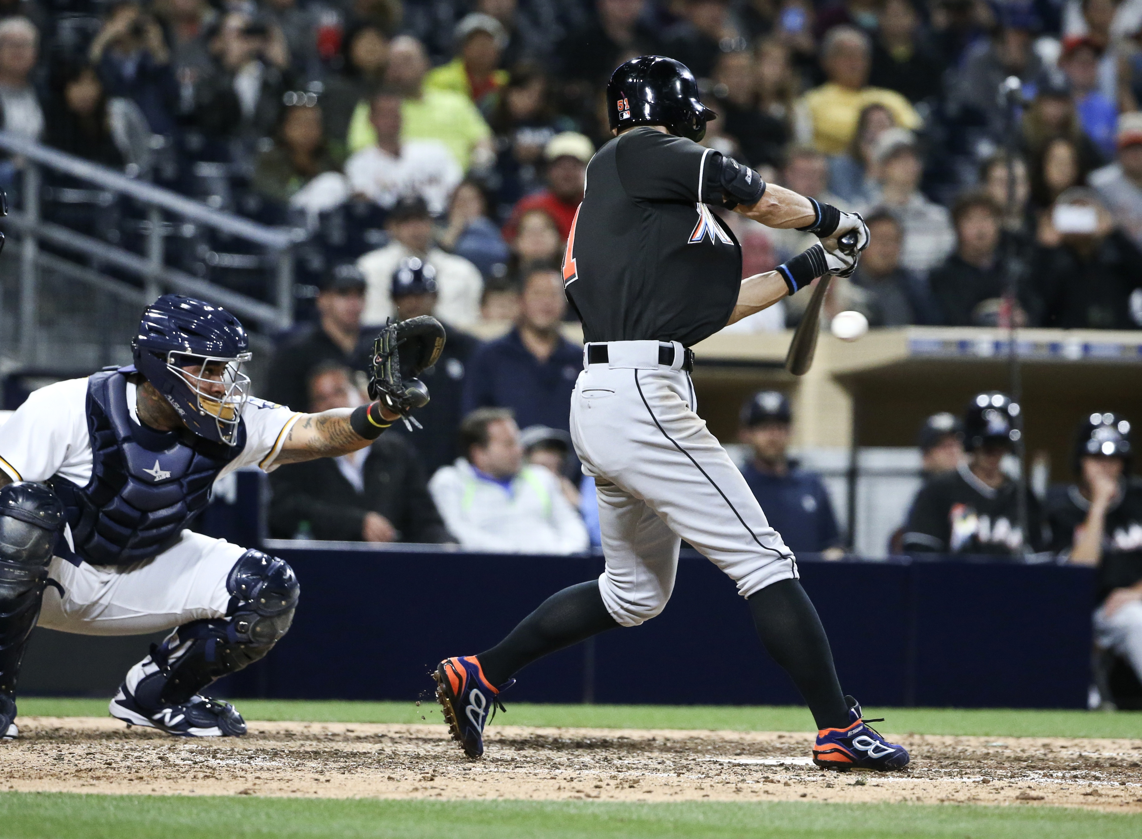 Miami Marlins' Ichiro Suzuki connects on his third hit of the night against the San Diego Padres, in the eighth inning of a baseball game Monday, June 13, 2016, in San Diego. (AP Photo/Lenny Ignelzi)