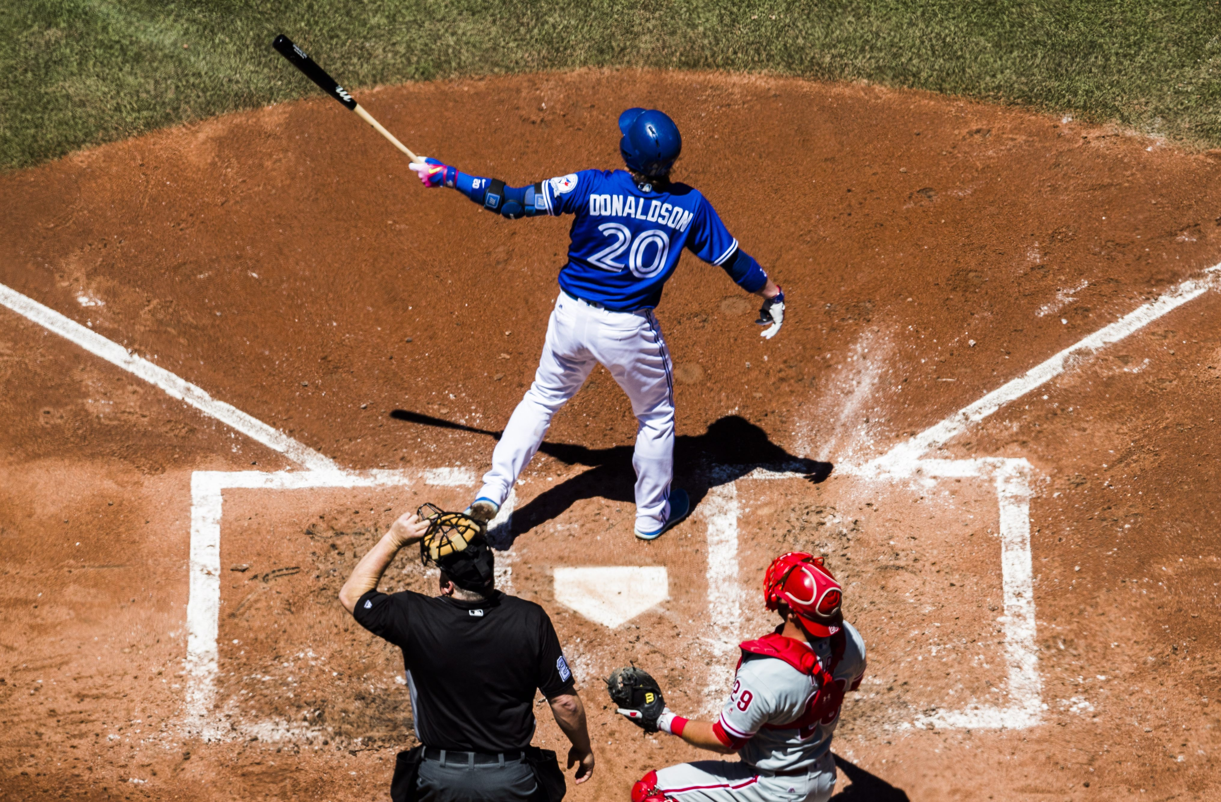 Toronto Blue Jays' Josh Donaldson hits a grand slam home run as Philadelphia Phillies catcher Cameron Rupp watches during the third inning of an interleague baseball action in Toronto, Tuesday, June 14, 2016. (Mark Blinch/The Canadian Press via AP)
