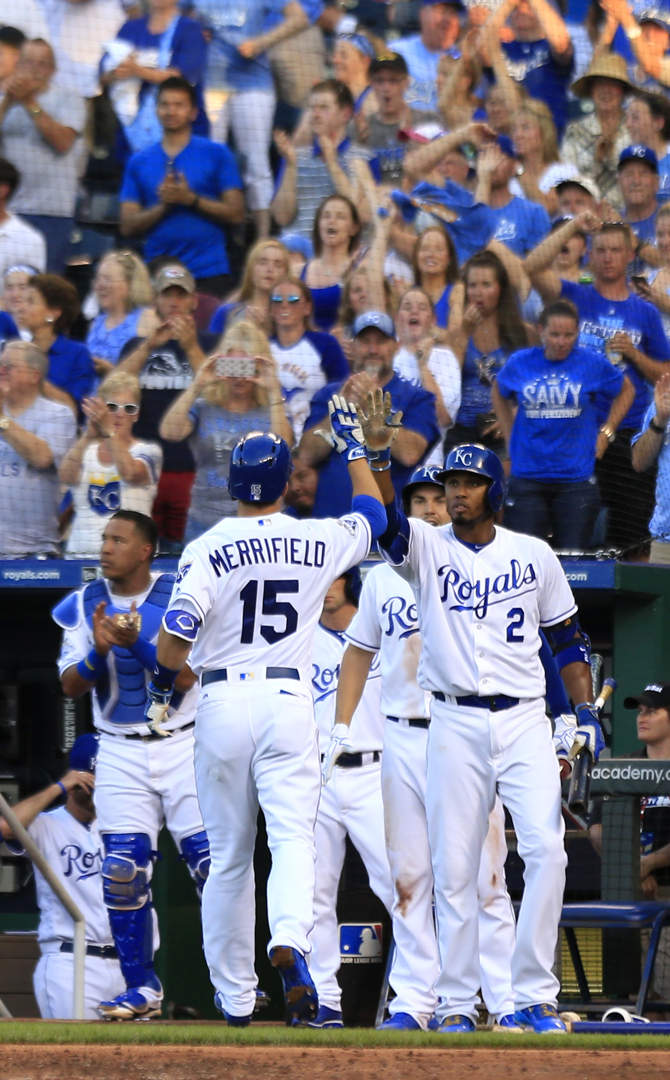Kansas City Royals' Whit Merrifield (15) is congratulated by teammate Alcides Escobar (2) after his solo home run off Cleveland Indians starting pitcher Josh Tomlin during the third inning of a baseball game at Kauffman Stadium in Kansas City, Mo., Tuesda