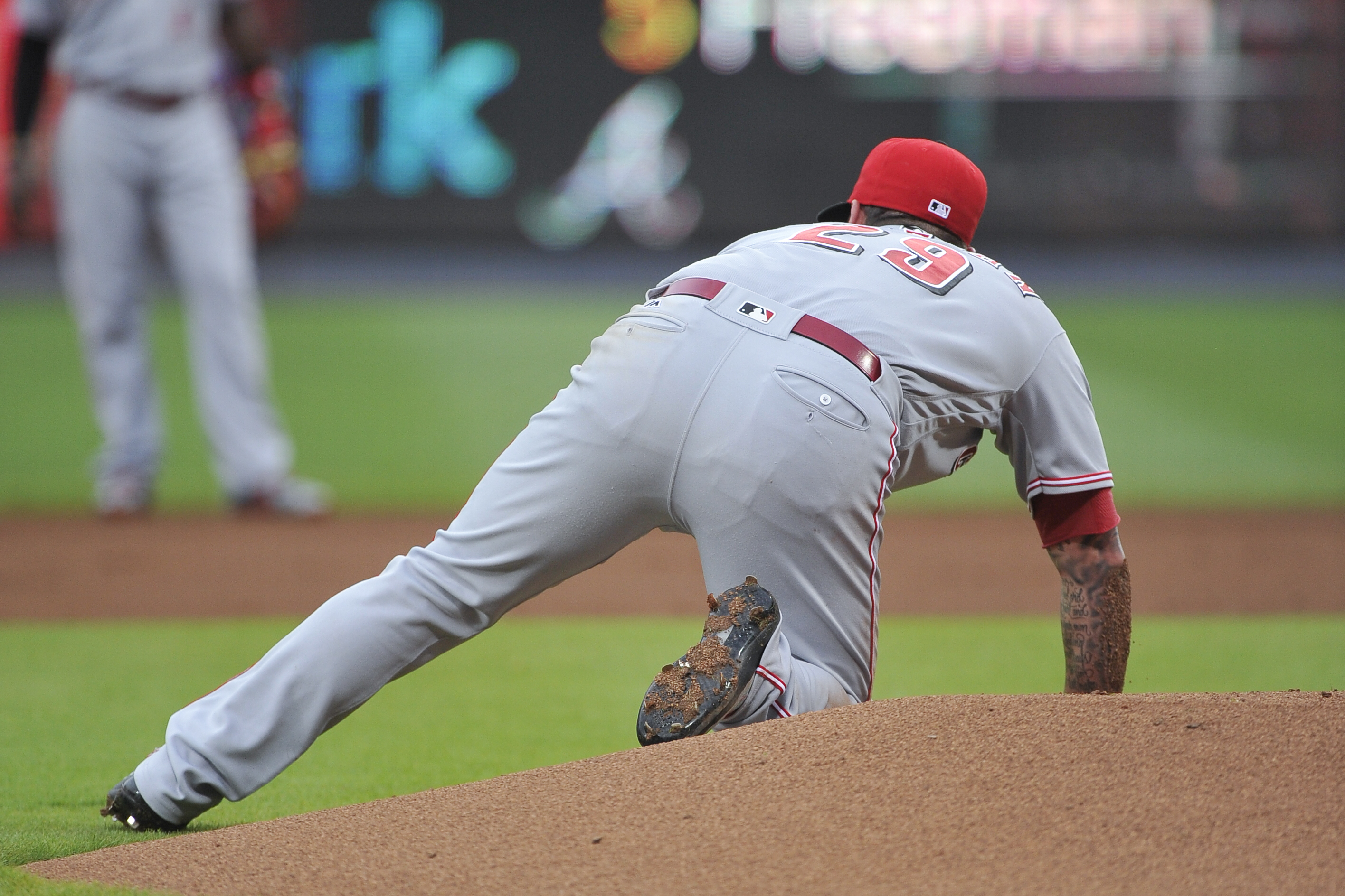 Cincinnati Reds' Brandon Finnegan gets up after falling from the mound while turning to attempt a pick-off throw of Atlanta Braves' Mallex Smith at second base during the first inning of a baseball game, Tuesday, June, 14, 2016, in Atlanta. (AP Photo/John