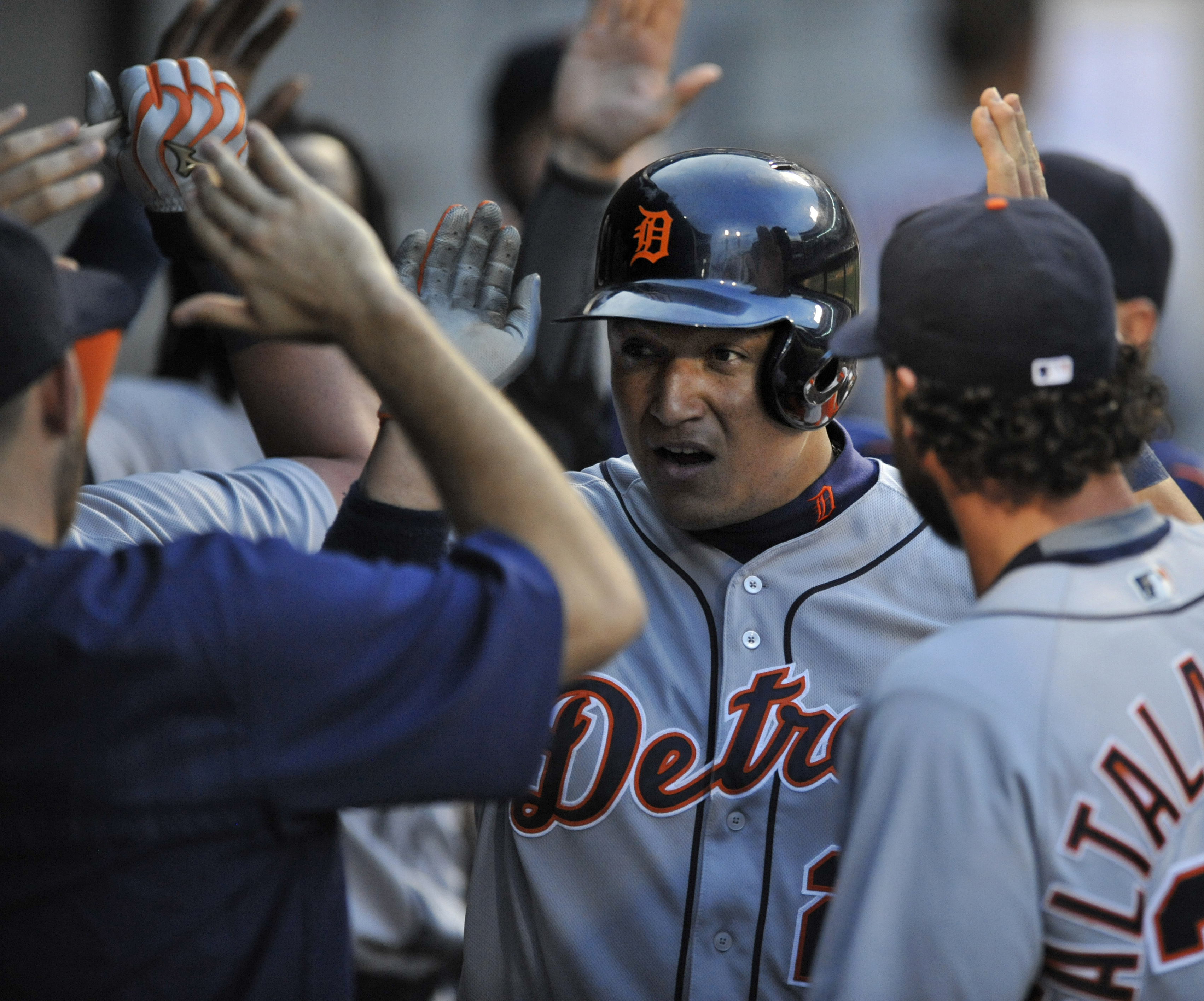 Detroit Tigers' Miguel Cabrera (24) celebrates with teammates in the dugout after scoring on James McCann sacrifice fly during the third inning of a baseball game against the Chicago White Sox Tuesday, June 14, 2016, in Chicago. (AP Photo/Paul Beaty)