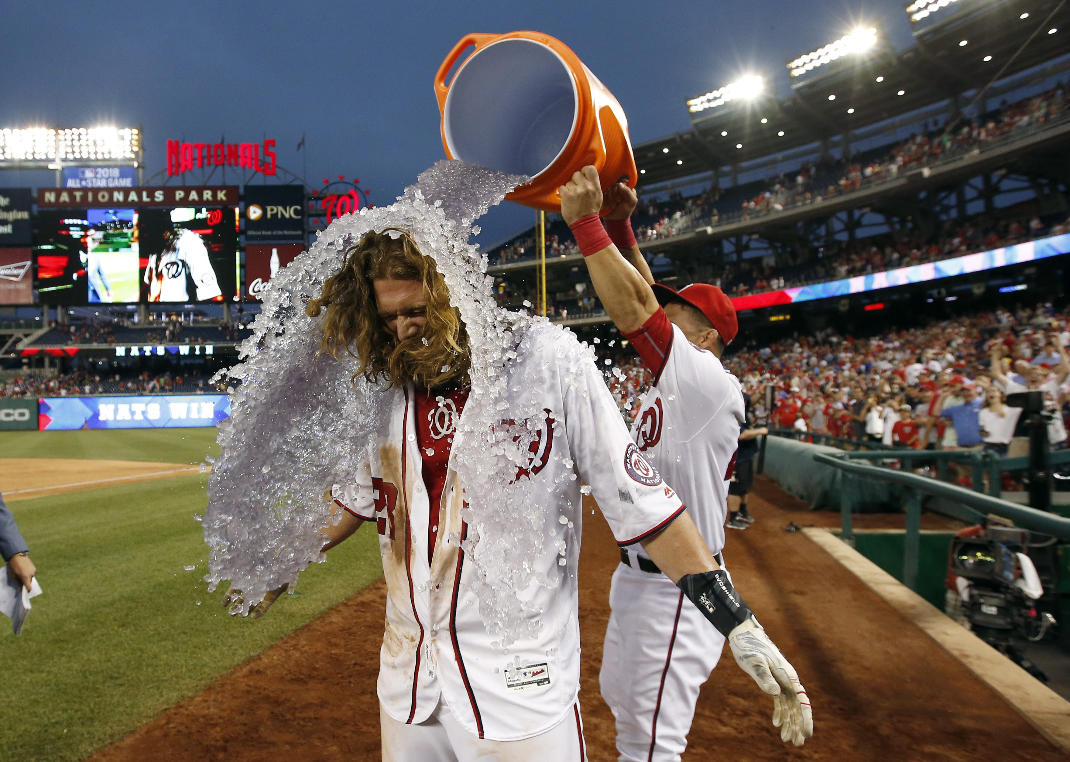 Washington Nationals' Jayson Werth gets doused by Wilson Ramos after a baseball game against the Chicago Cubs at Nationals Park, Wednesday, June 15, 2016, in Washington. Werth hit the game-winning RBI single. The Nationals won 5-4, in 12 innings. (AP Phot