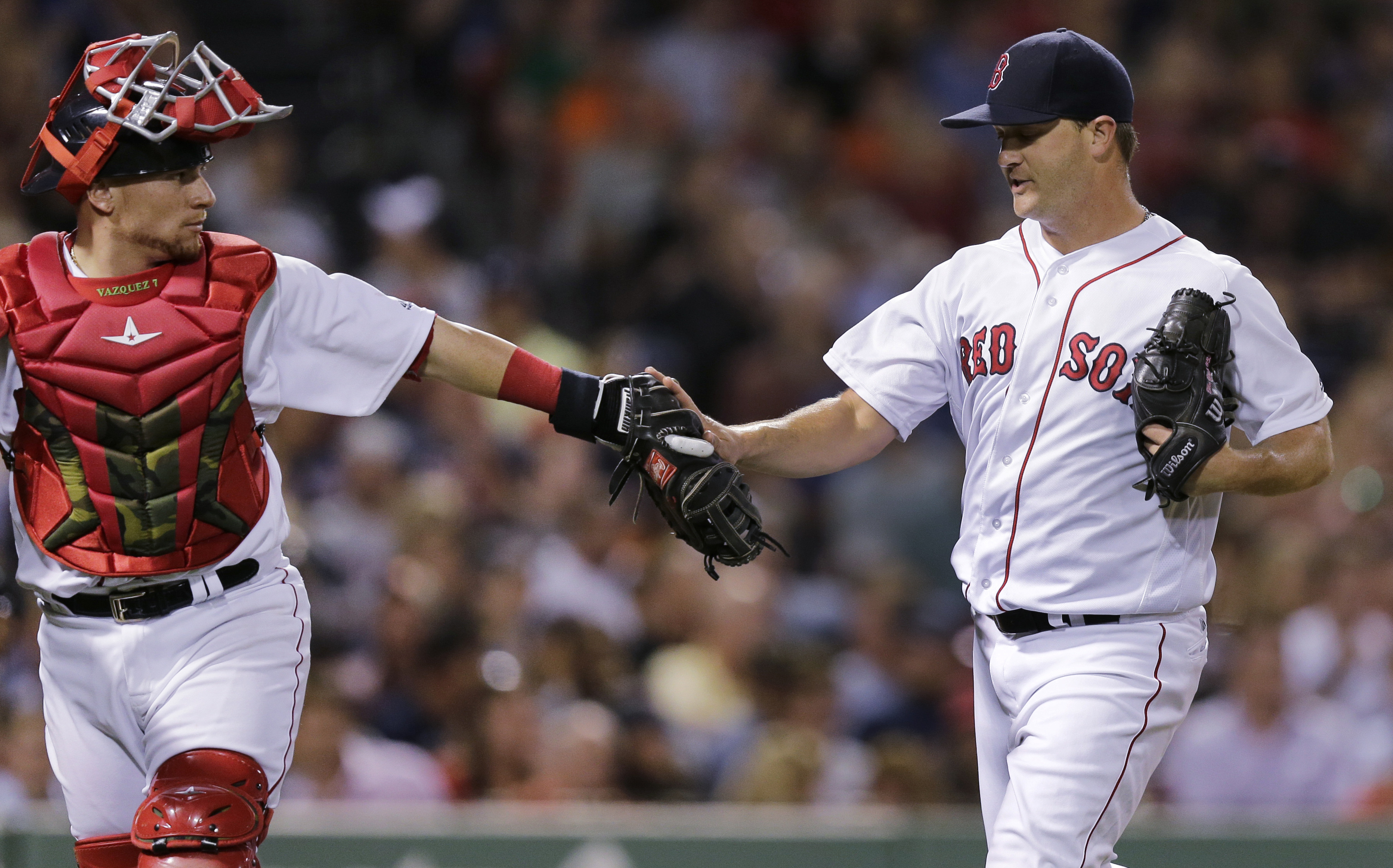 Boston Red Sox starting pitcher Steven Wright, right, is congratulated by catcher Christian Vazquez after a quick sixth inning on the mound during a baseball game against the Baltimore Orioles at Fenway Park, Wednesday, June 15, 2016, in Boston. (AP Photo
