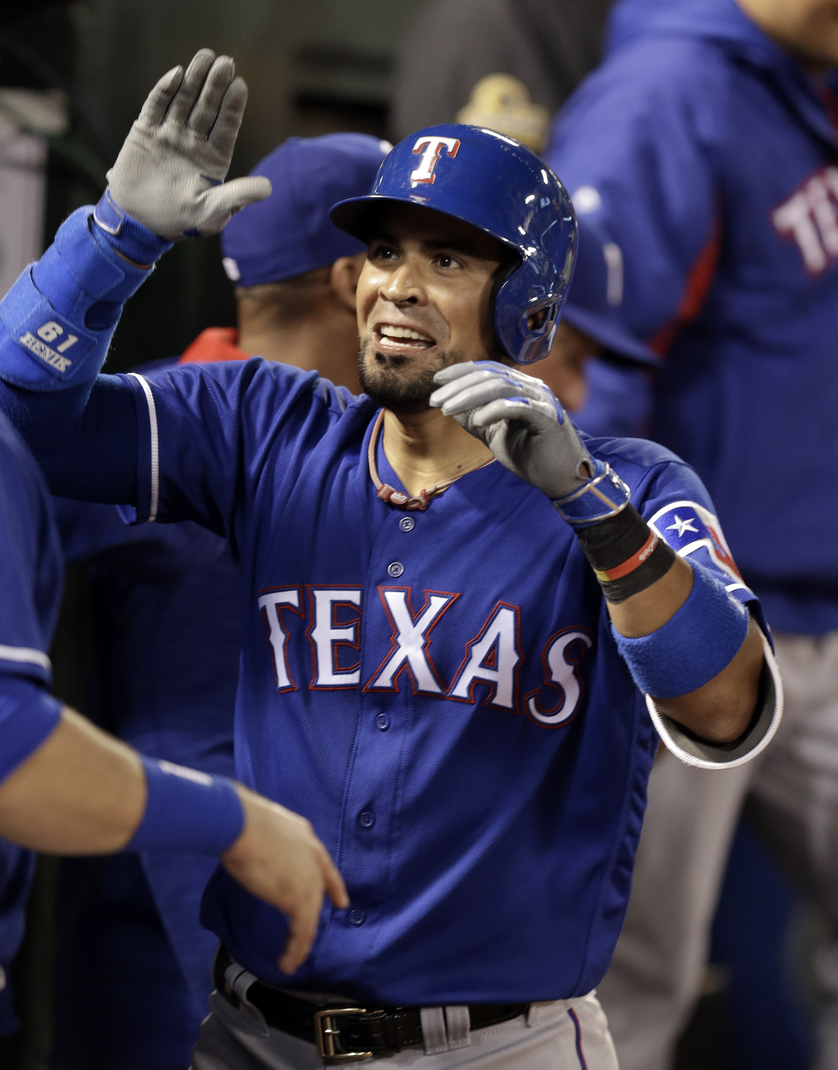 Texas Rangers' Robinson Chirinos celebrates after hitting a home run off Oakland Athletics' John Axford in the seventh inning of a baseball game Wednesday, June 15, 2016, in Oakland, Calif. (AP Photo/Ben Margot)