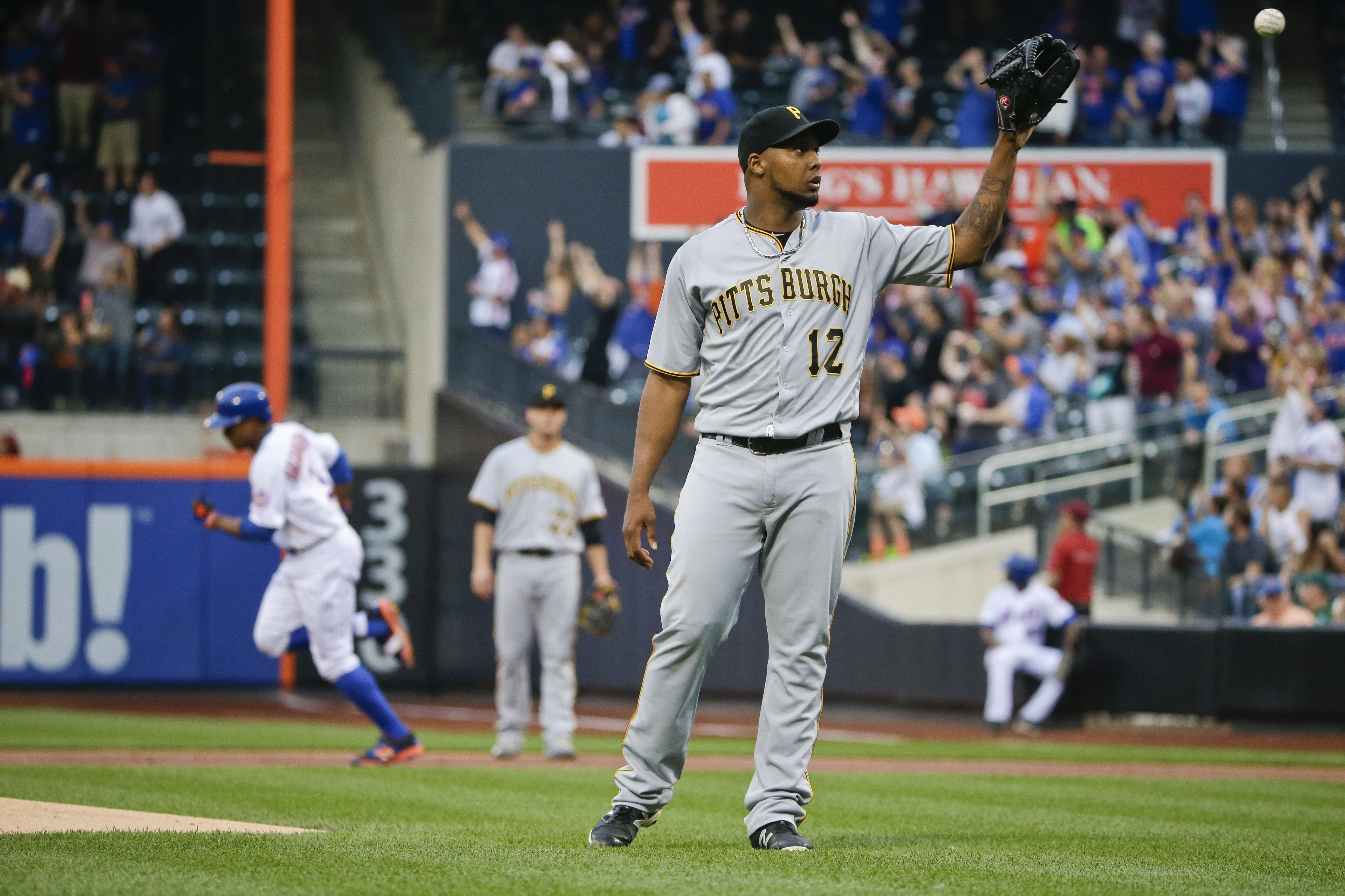 Pittsburgh Pirates starting pitcher Juan Nicasio (12) gets a new ball as New York Mets' Curtis Granderson runs the bases after hitting a home run during the first inning of a baseball game Thursday, June 16, 2016, in New York. (AP Photo/Frank Franklin II)