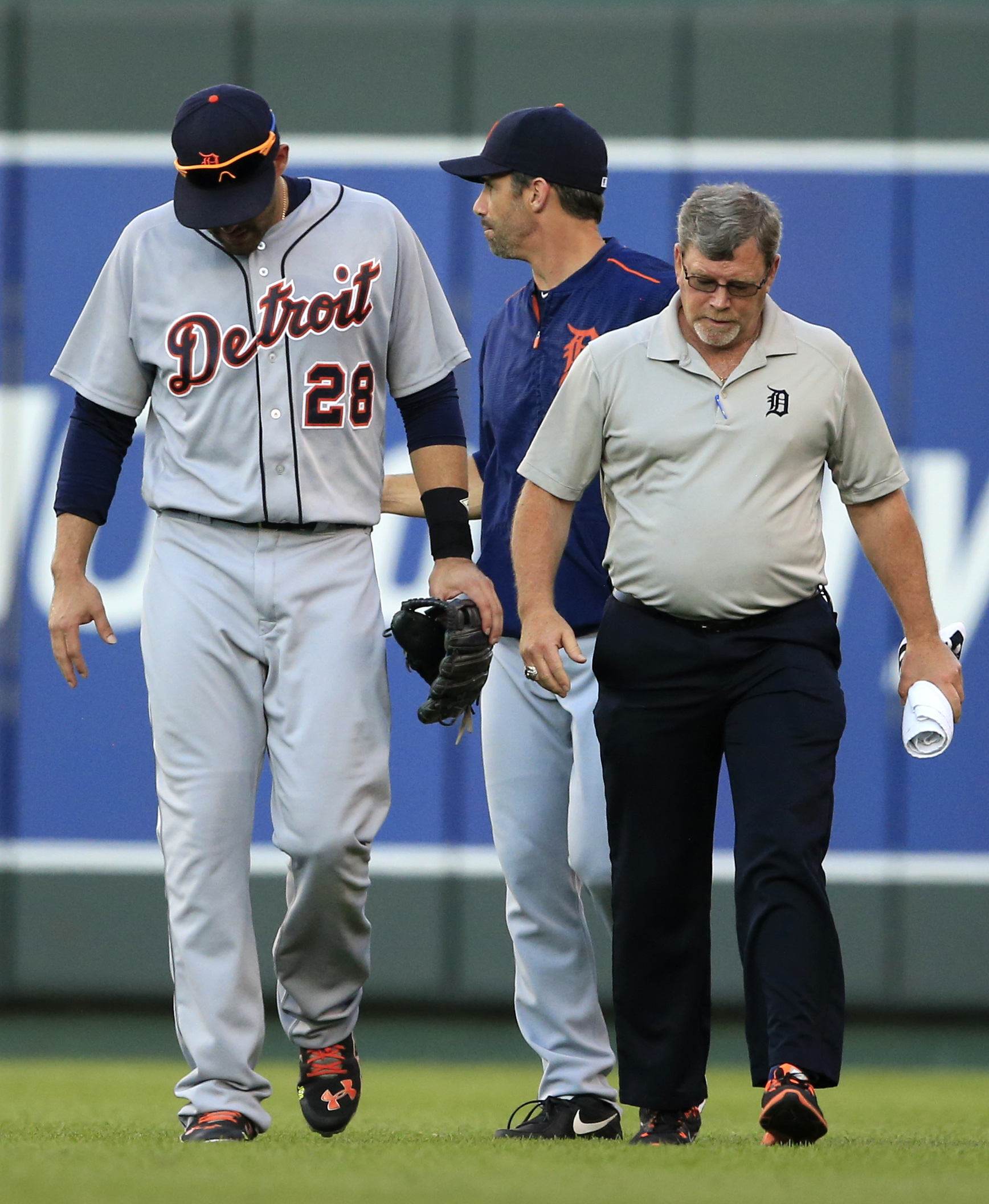 Injured Detroit Tigers right fielder J.D. Martinez (28) leaves the baseball game against the Kansas City Royals during the second inning at Kauffman Stadium in Kansas City, Mo., Thursday, June 16, 2016. (AP Photo/Orlin Wagner)