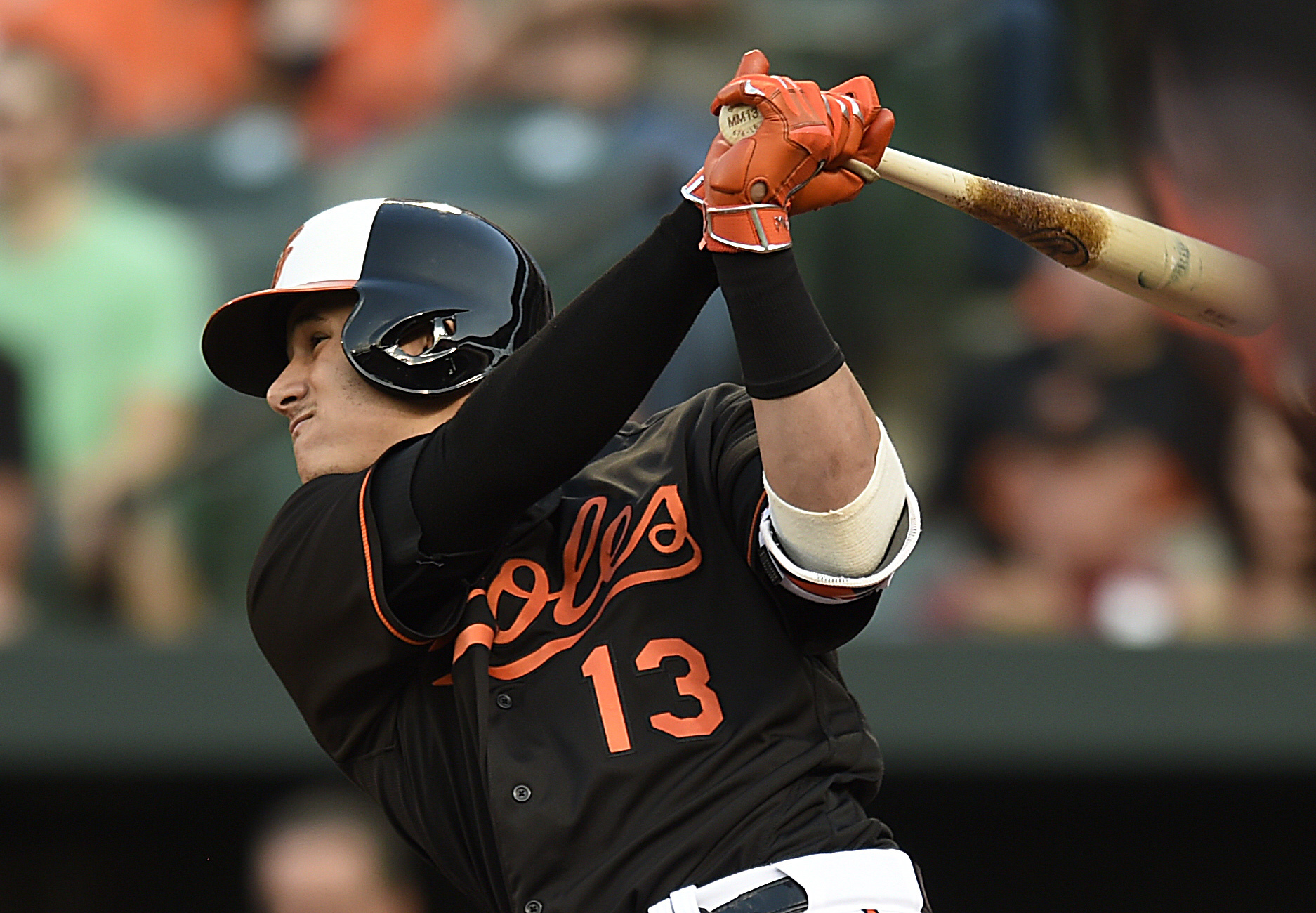 Baltimore Orioles' Manny Machado follows through on an RBI-single against the Toronto Blue Jays in the first inning of a baseball game, Friday, June 17, 2016 in Baltimore. (AP Photo/Gail Burton)