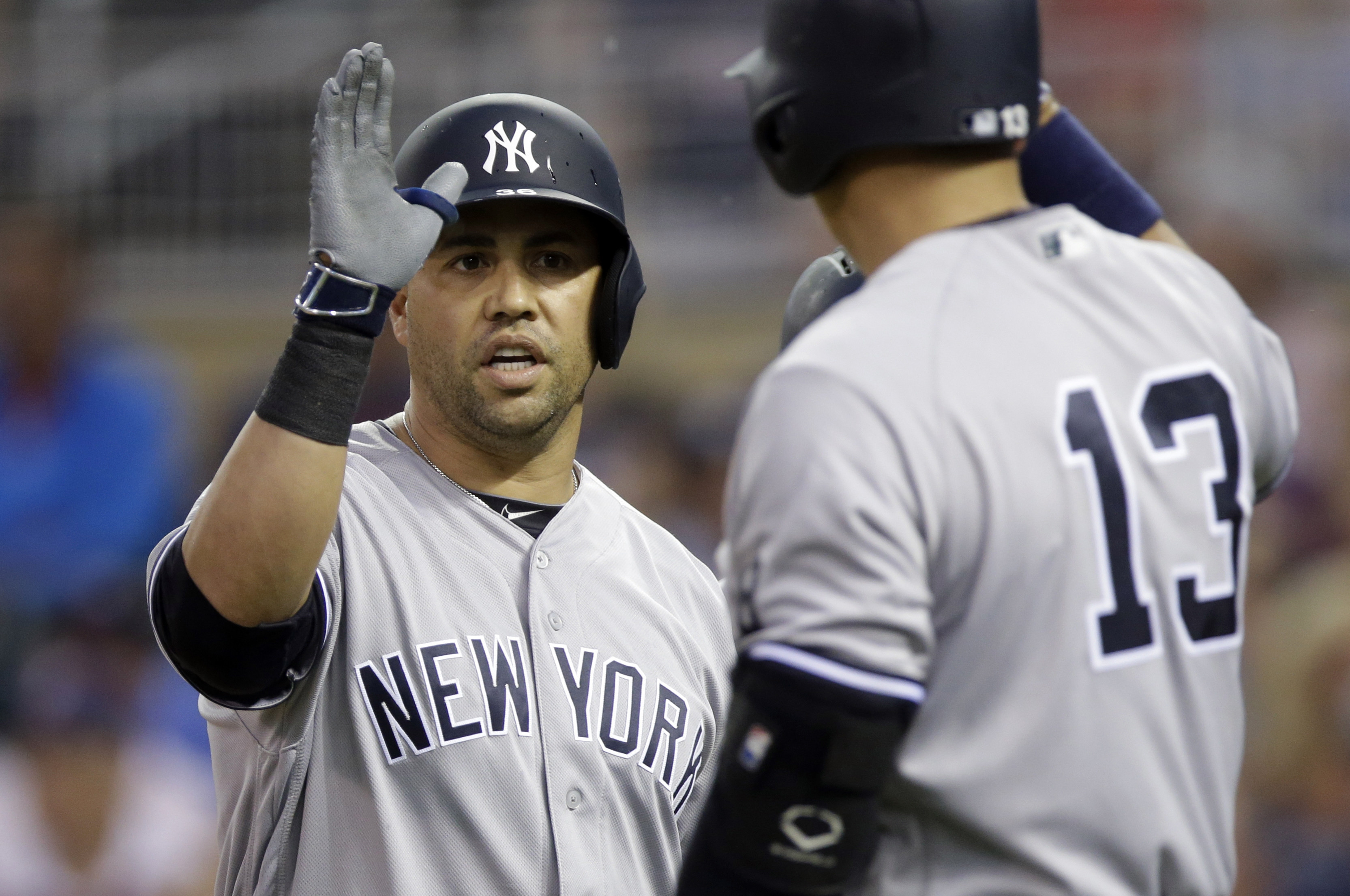 New York Yankees' Carlos Beltran, left, gets a high five from Alex Rodriguez following his two-run home run off Minnesota Twins pitcher Pat Dean in the first inning of a baseball game Friday, June 17, 2016, in Minneapolis. (AP Photo/Jim Mone)