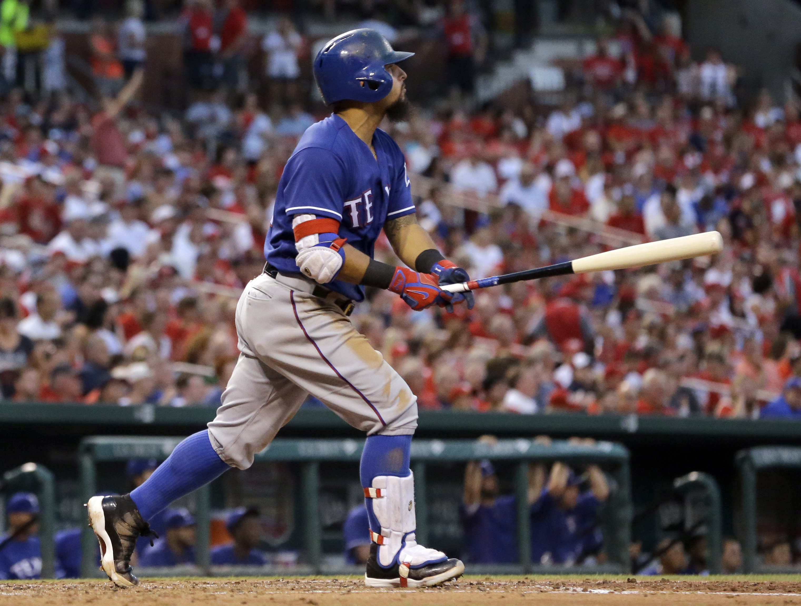 Texas Rangers' Rougned Odor watches his solo home run during the fifth inning of a baseball game against the St. Louis Cardinals Friday, June 17, 2016, in St. Louis. (AP Photo/Jeff Roberson)