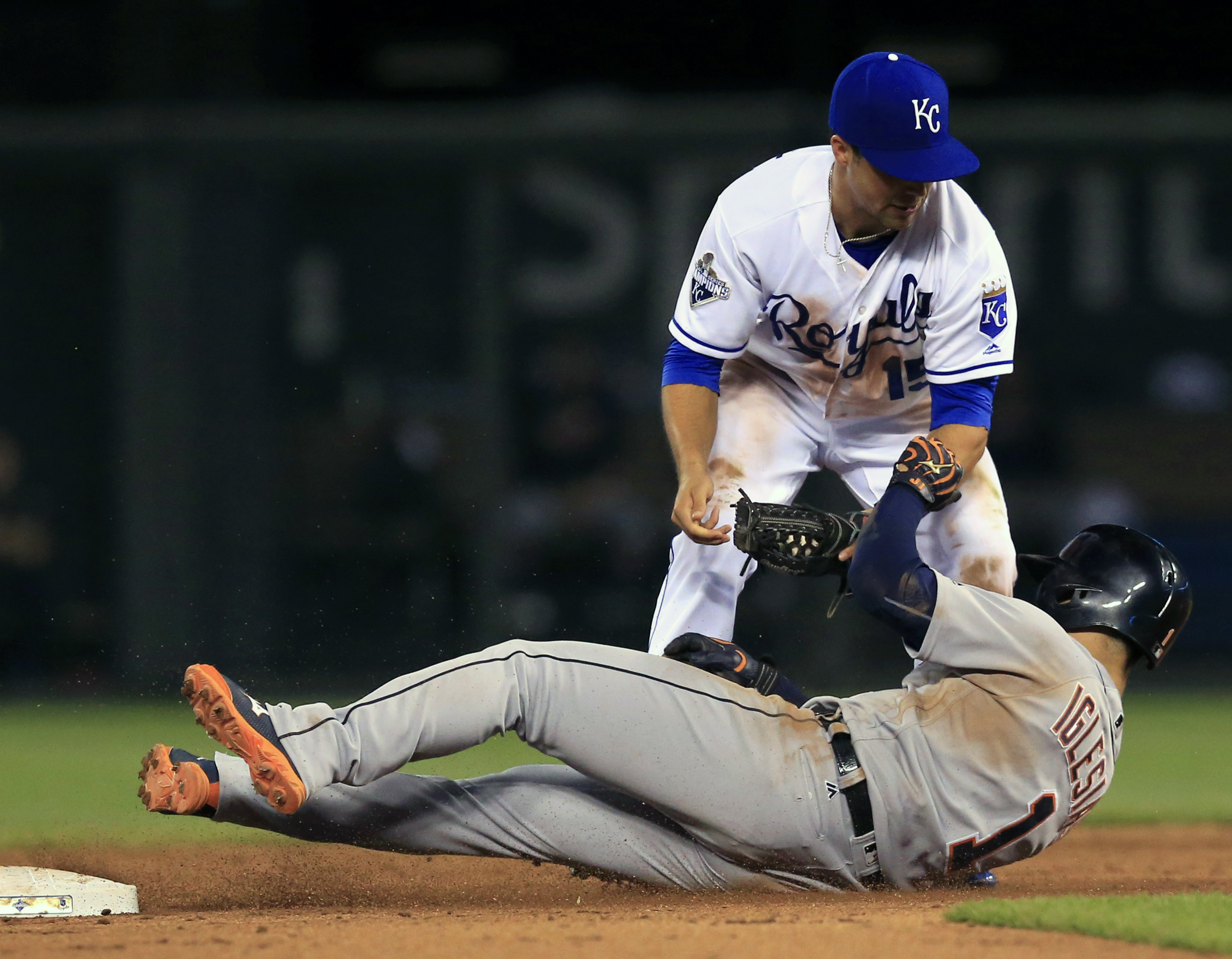 Kansas City Royals second baseman Whit Merrifield (15) tags out Detroit Tigers' Jose Iglesias (1) during the seventh inning of a baseball game at Kauffman Stadium in Kansas City, Mo., Saturday, June 18, 2016. Iglesias was out on a fielder's choice on the