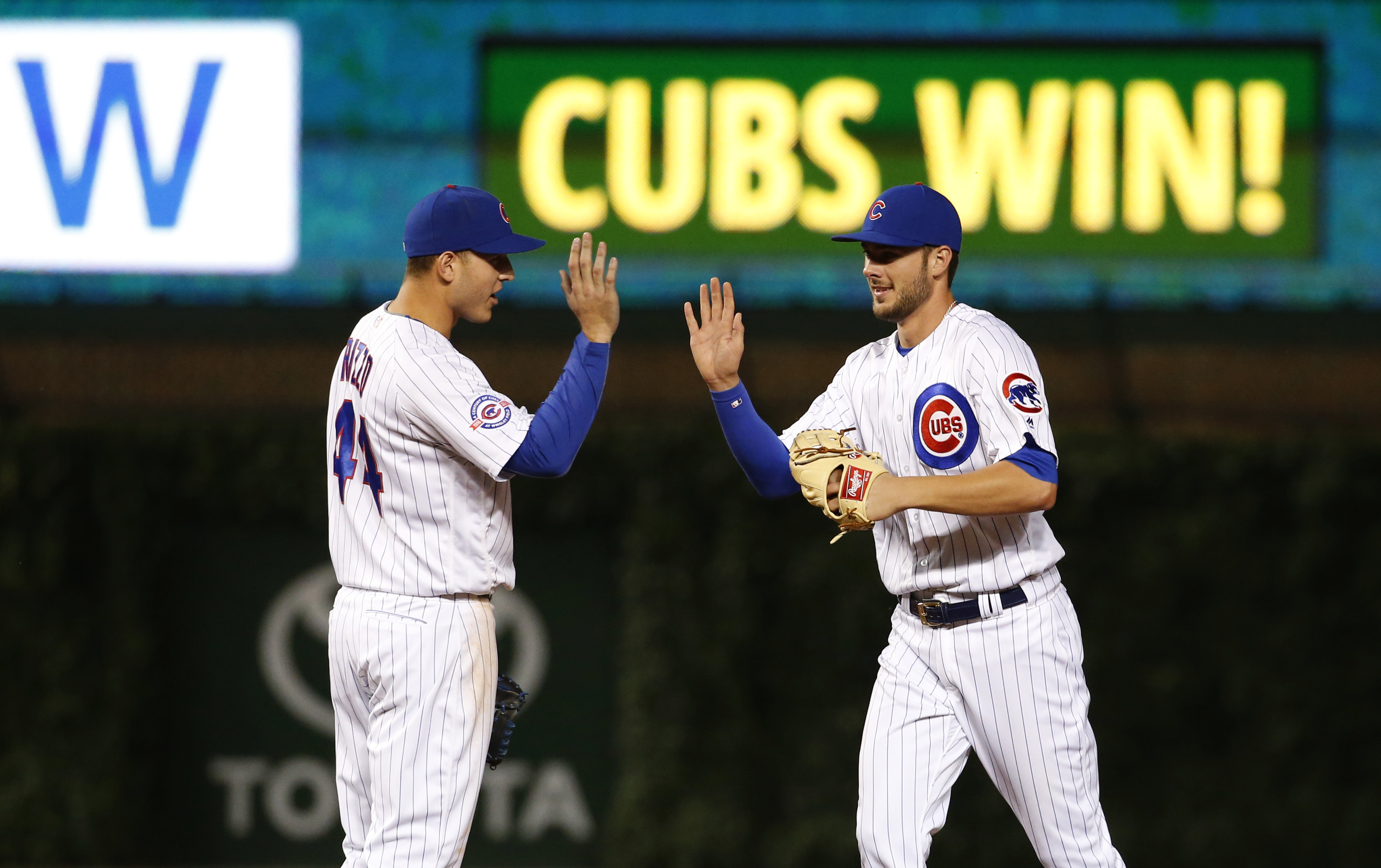 Chicago Cubs' Anthony Rizzo, left, celebrates with Kris Bryant after the Cubs defeated the Pittsburgh Pirates 4-3 in a baseball game Saturday, June 18, 2016, in Chicago. (AP Photo/Nam Y. Huh)