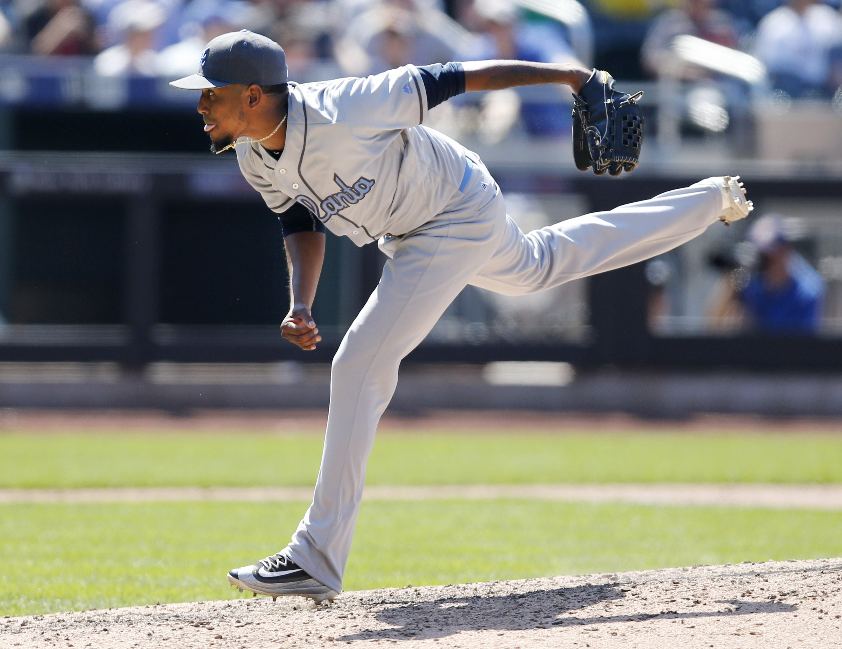 Atlanta Braves starting pitcher Julio Teheran (49) follows through on a pitch during the eighth inning of a baseball game against the New York Mets, Sunday, June 19, 2016, in New York. (AP Photo/Kathy Willens)