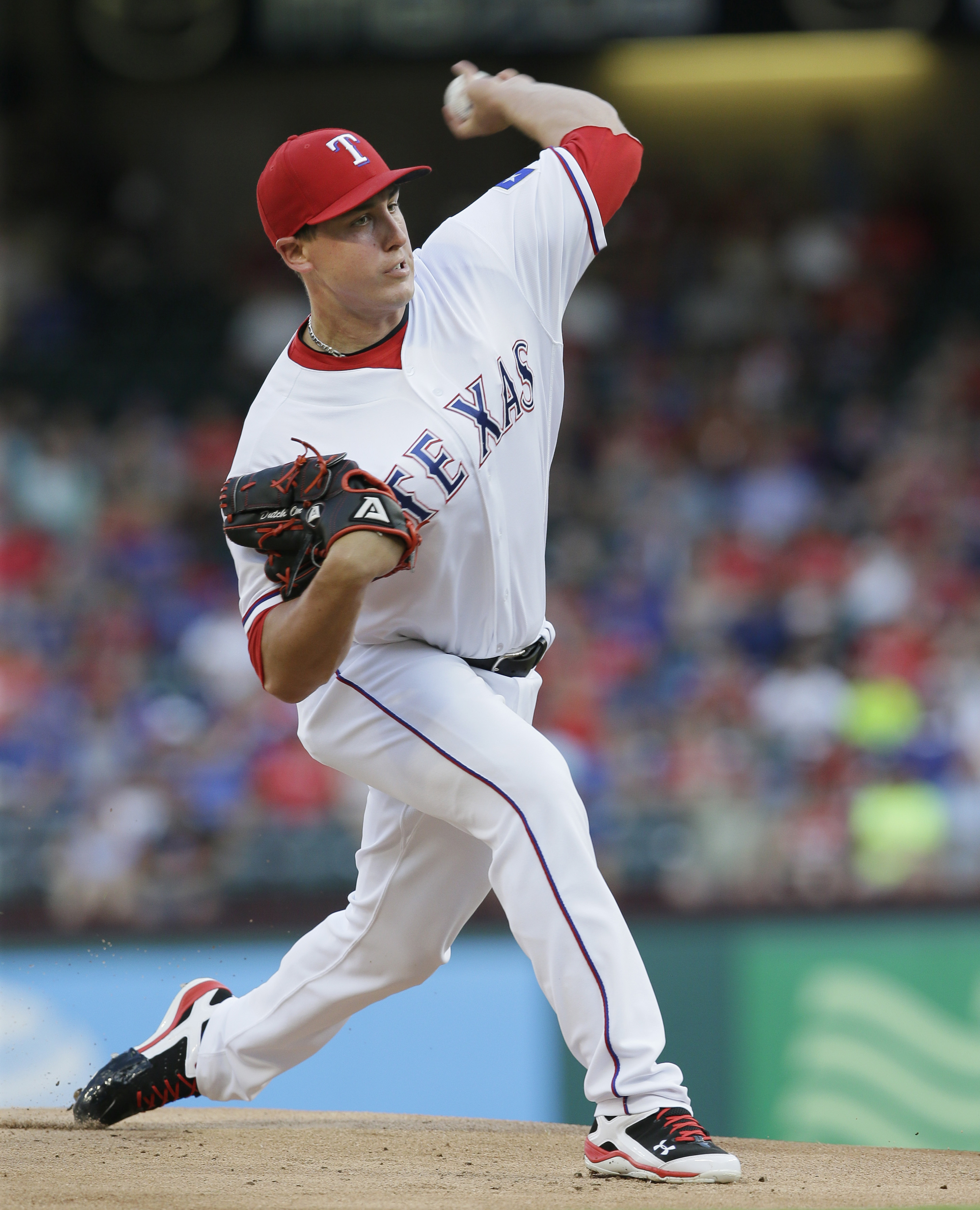 Texas Rangers starting pitcher Derek Holland throws during the first inning of a baseball game against the Baltimore Orioles in Arlington, Texas, Monday, June 20, 2016. (AP Photo/LM Otero)