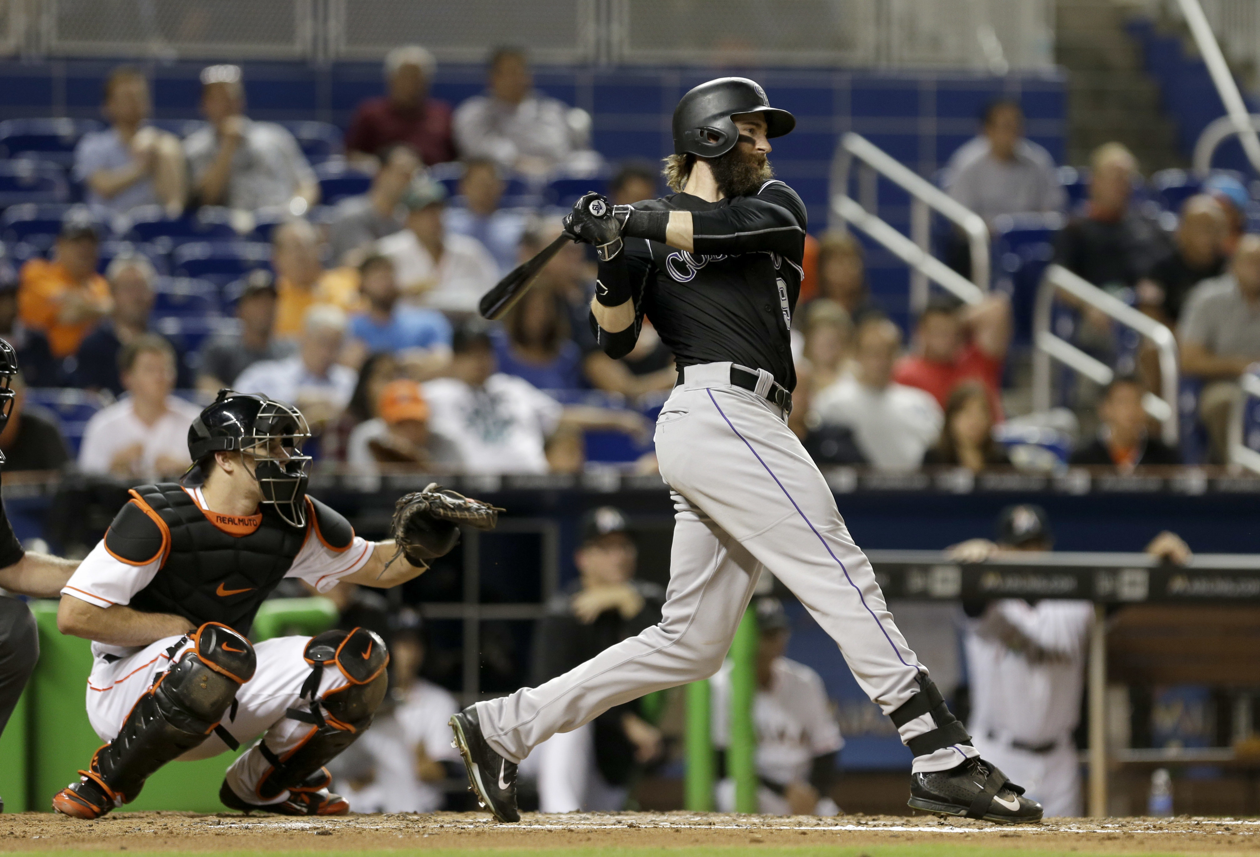 Colorado Rockies' Charlie Blackmon follows through on a base hit against the Miami Marlins during the fifth inning of a baseball game Monday, June 20, 2016, in Miami. (AP Photo/Alan Diaz)