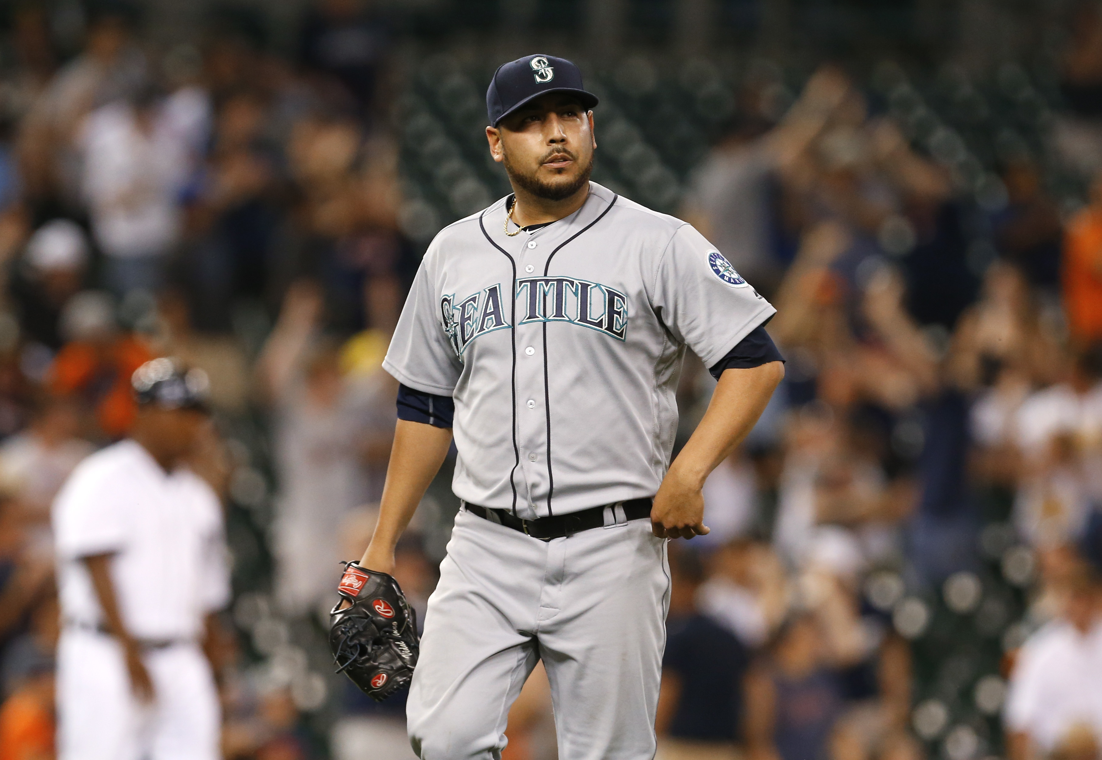 Seattle Mariners relief pitcher Vidal Nuno walks off the field after giving up a solo home run to Detroit Tigers' Justin Upton during the 12th inning of a baseball game in Detroit, Monday, June 20, 2016. Detroit won 8-7. (AP Photo/Paul Sancya)