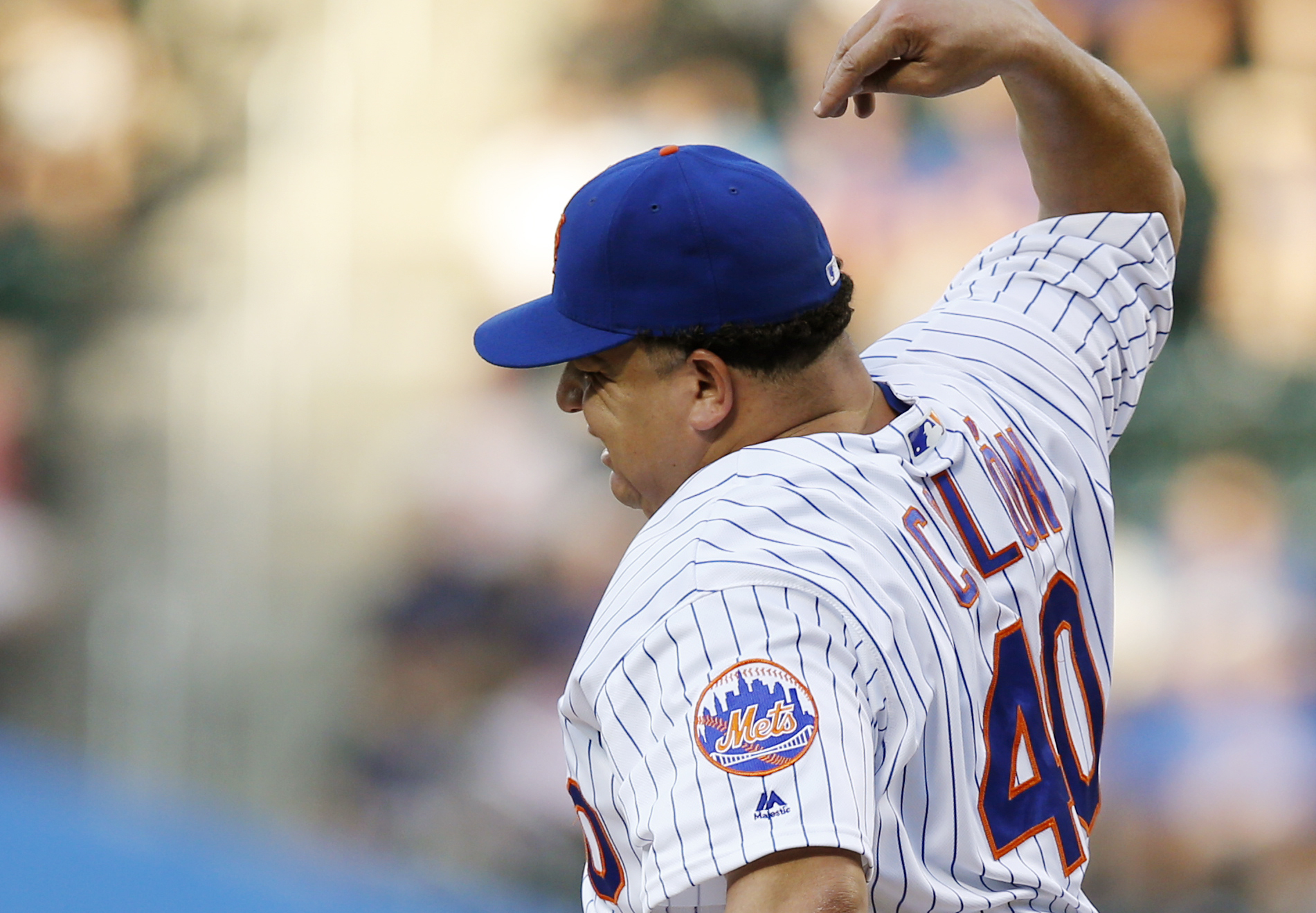New York Mets starting pitcher Bartolo Colon (40) reacts after he was hit on the hand by Kansas City Royals Whit Merrifield's first-inning, ground ball during a baseball game against the Kansas City Royals, Tuesday, June 21, 2016, in New York. Colon left