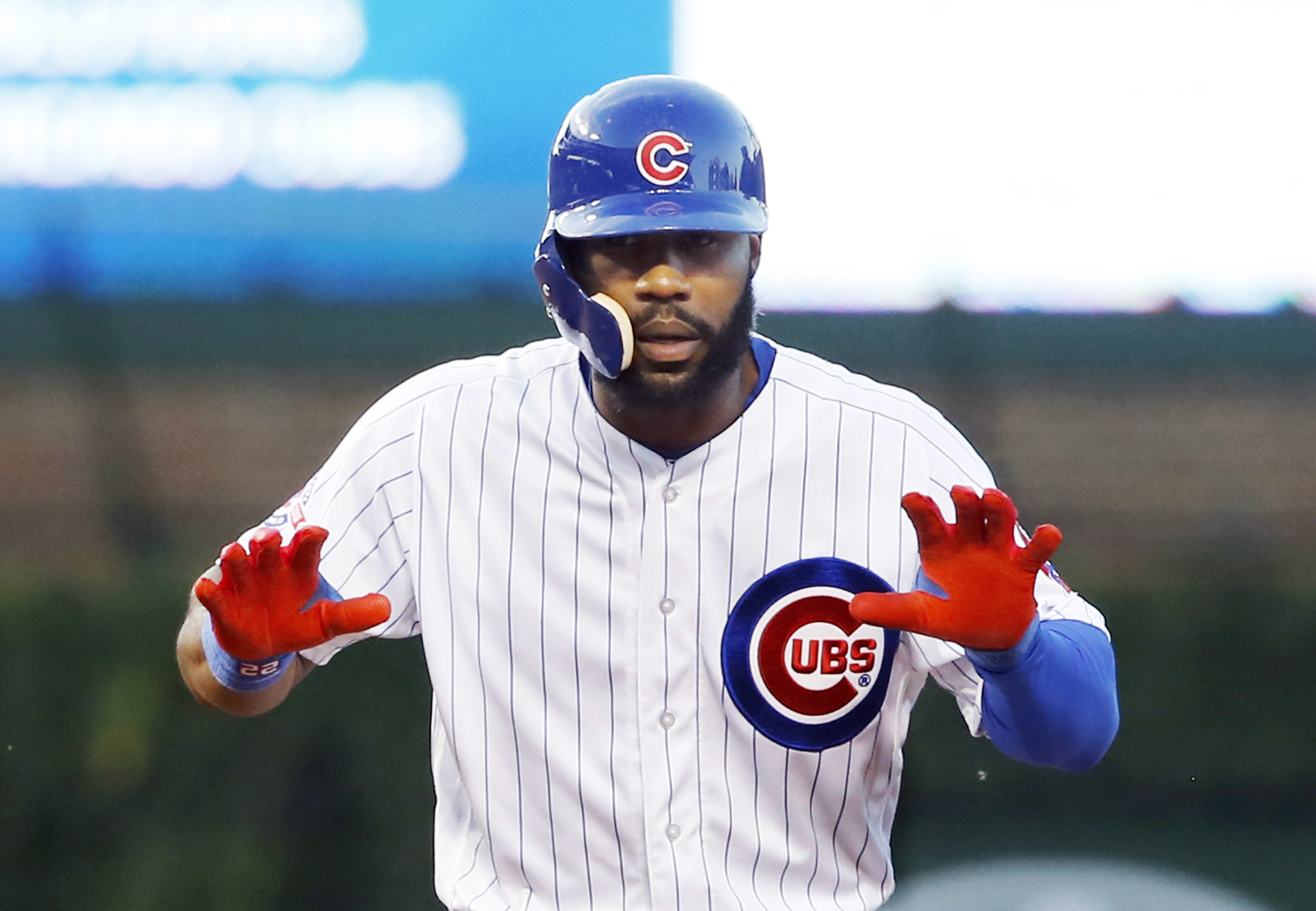 Chicago Cubs' Jason Heyward reacts after hitting an RBI double off St. Louis Cardinals starting pitcher Adam Wainwright, scoring Chris Coghlan during the third inning of a baseball game Tuesday, June 21, 2016, in Chicago. (AP Photo/Charles Rex Arbogast)