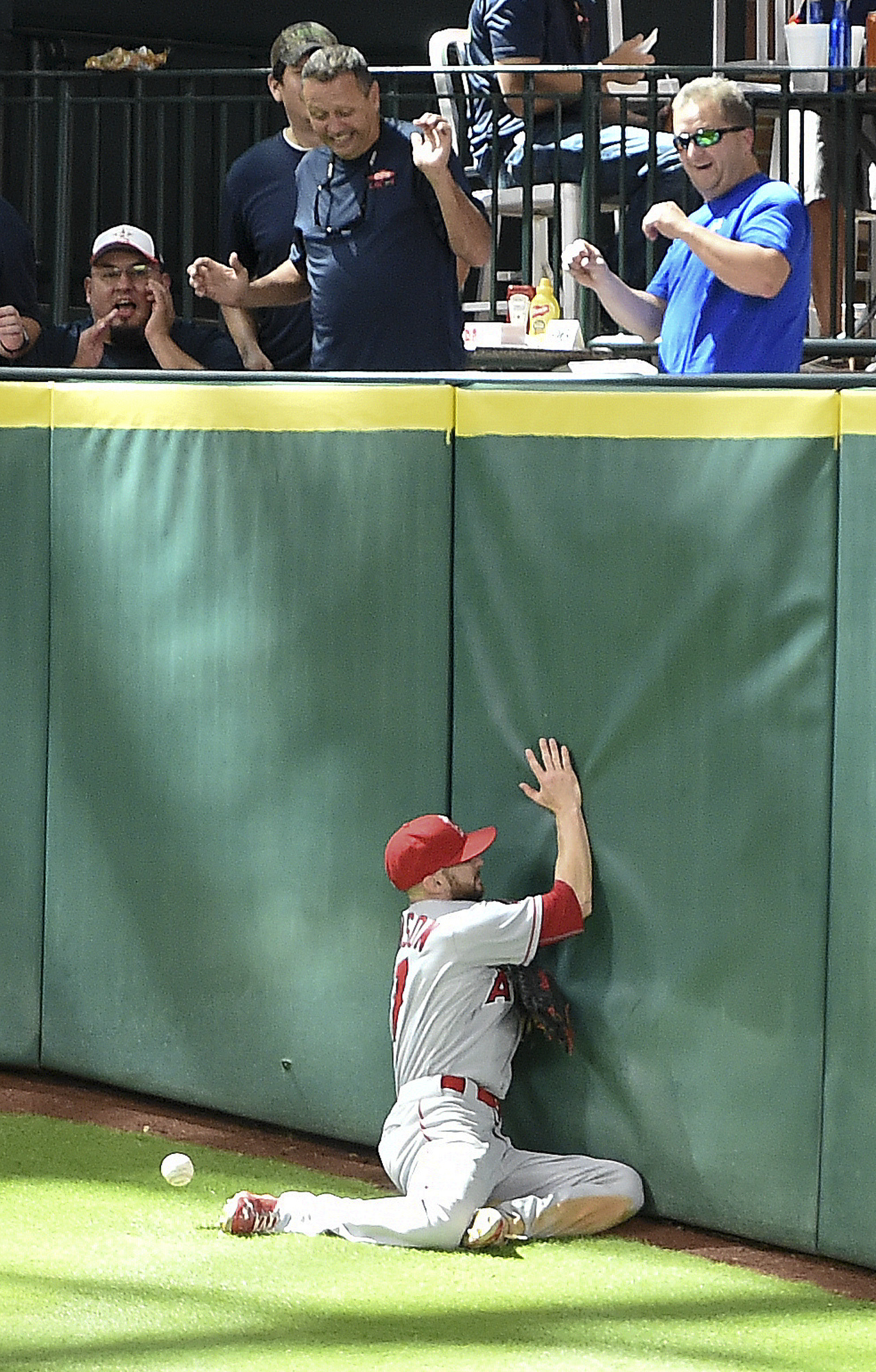 Los Angeles Angels center fielder Shane Robinson can't get to Houston Astros' Marwin Gonzalez triple in the eighth inning of a baseball game, Wednesday, June 22, 2016, in Houston. (AP Photo/Eric Christian Smith)