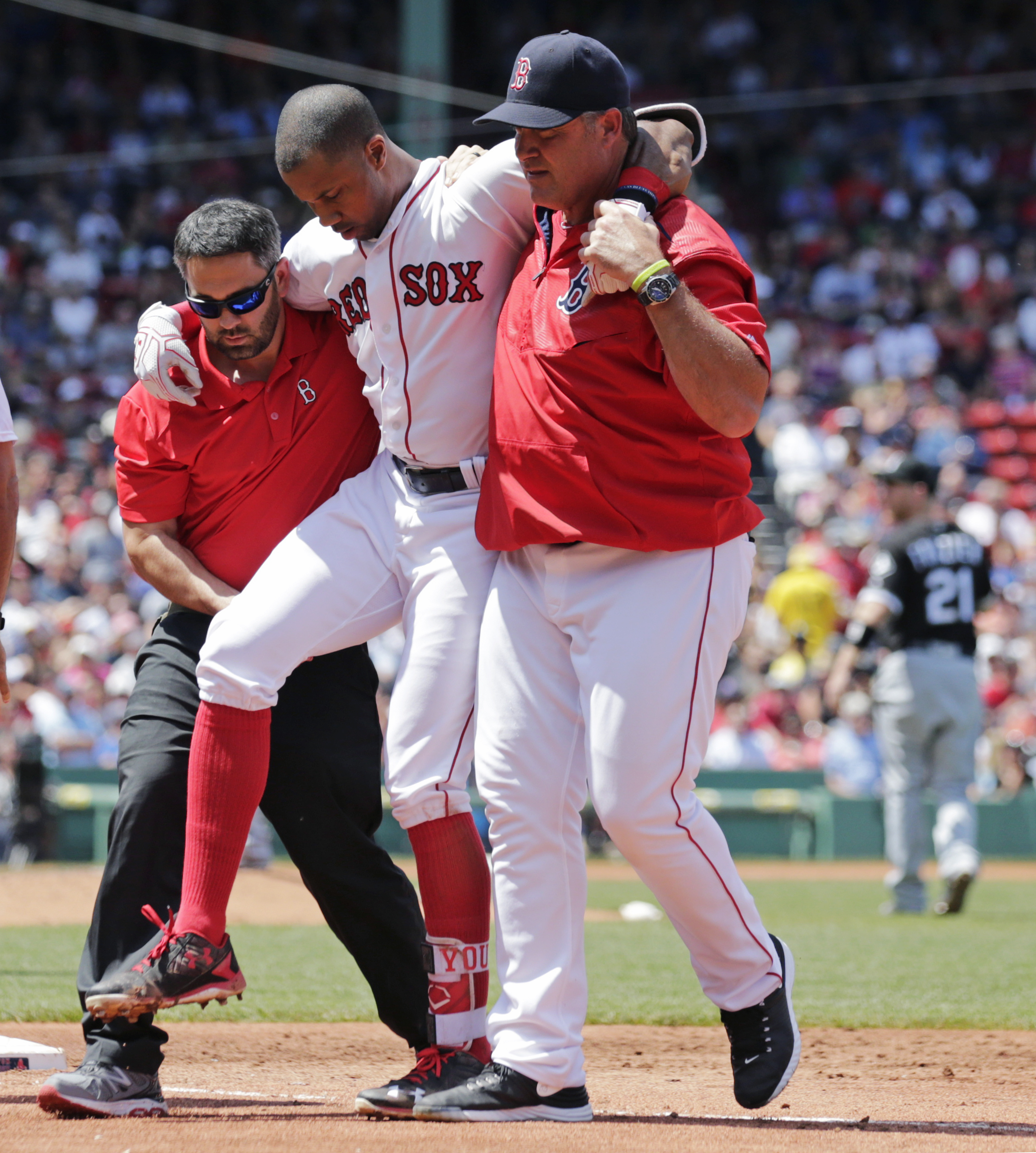 Boston Red Sox's Chris Young, center, is helped off the field by manager John Farrell, right, and trainer Brad Pearson after an apparent injury to his right leg caused while rounding first base during the second inning of a baseball game against the Chica