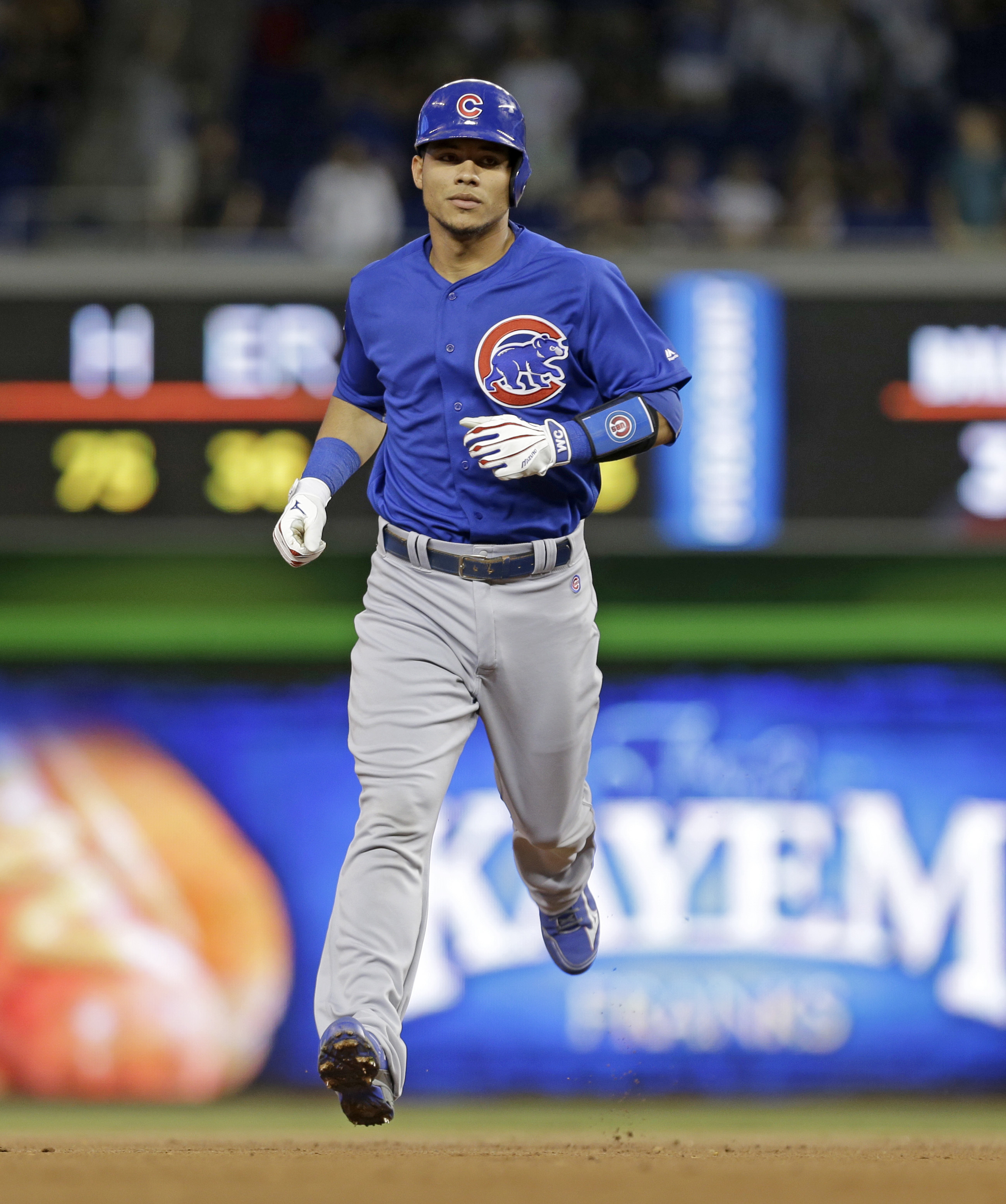Chicago Cubs' Willson Contreras rounds the bases after hitting a two-run home run against the Miami Marlins in the first inning of a baseball game, Friday, June 24, 2016, in Miami. Ben Zobrist scored on the home run. (AP Photo/Alan Diaz)