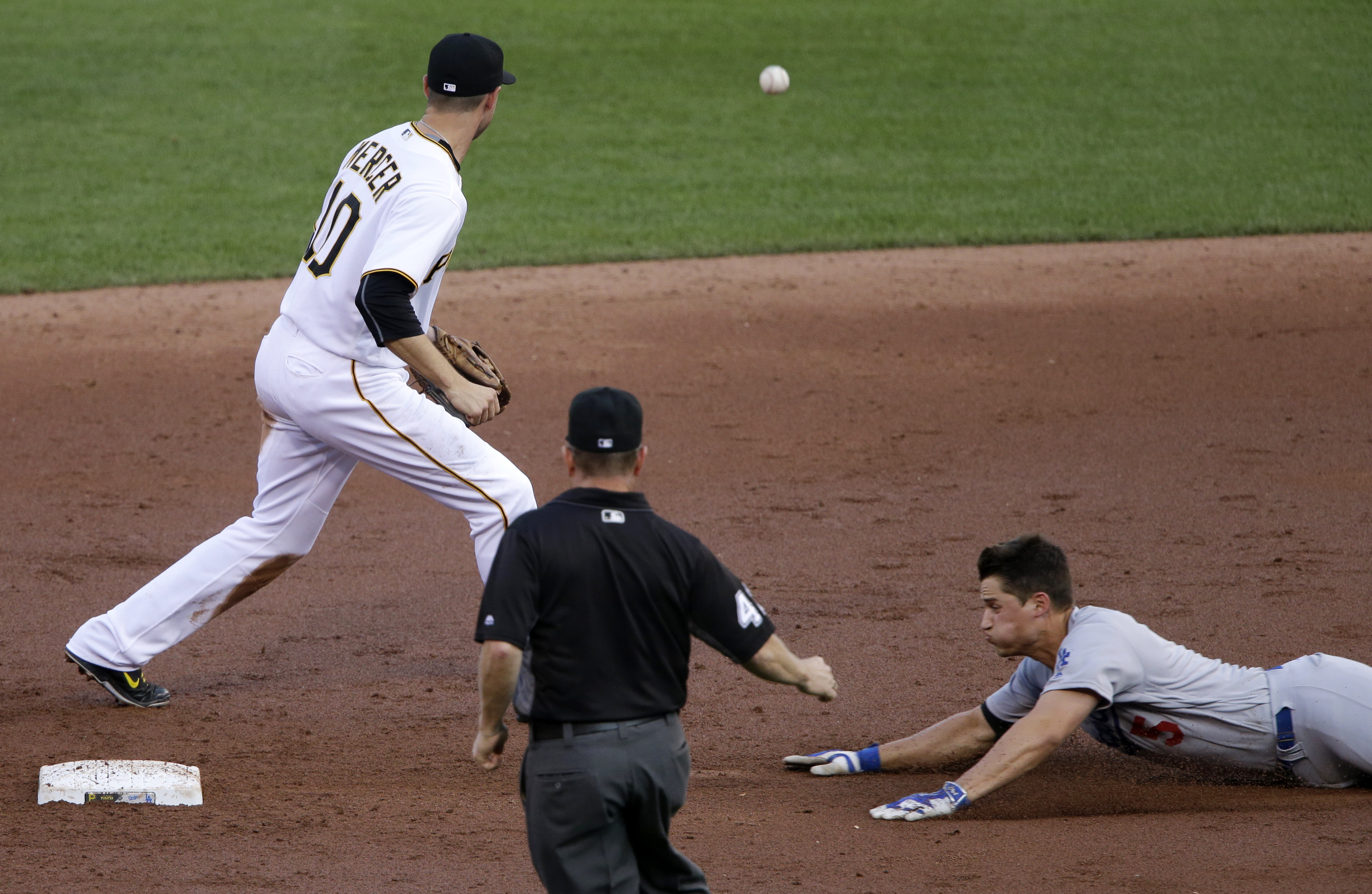 Los Angeles Dodgers' Corey Seager, right, slides into second with a double as Pittsburgh Pirates shortstop Jordy Mercer (10) waits for the throw during the third inning of a baseball game in Pittsburgh, Friday, June 24, 2016. (AP Photo/Gene J. Puskar)