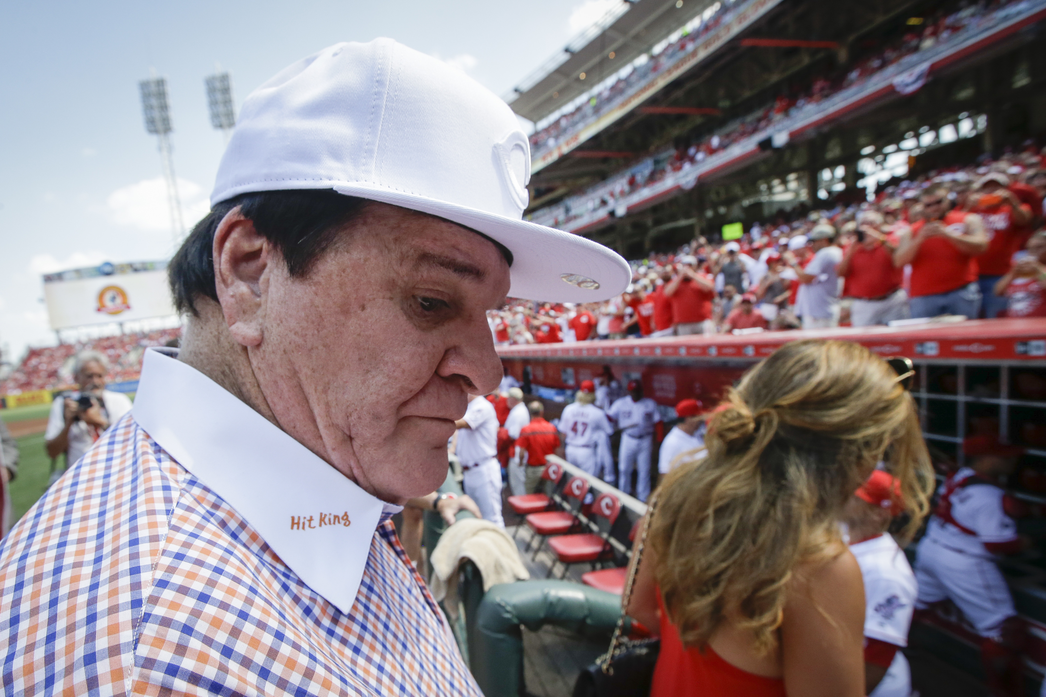 Former Cincinnati Reds player and manager Pete Rose walks into the dugout as fan cheer following a ceremony to induct him into the Cincinnati Reds Hall of Fame before a baseball game against the San Diego Padres, Saturday, June 25, 2016, in Cincinnati. (A