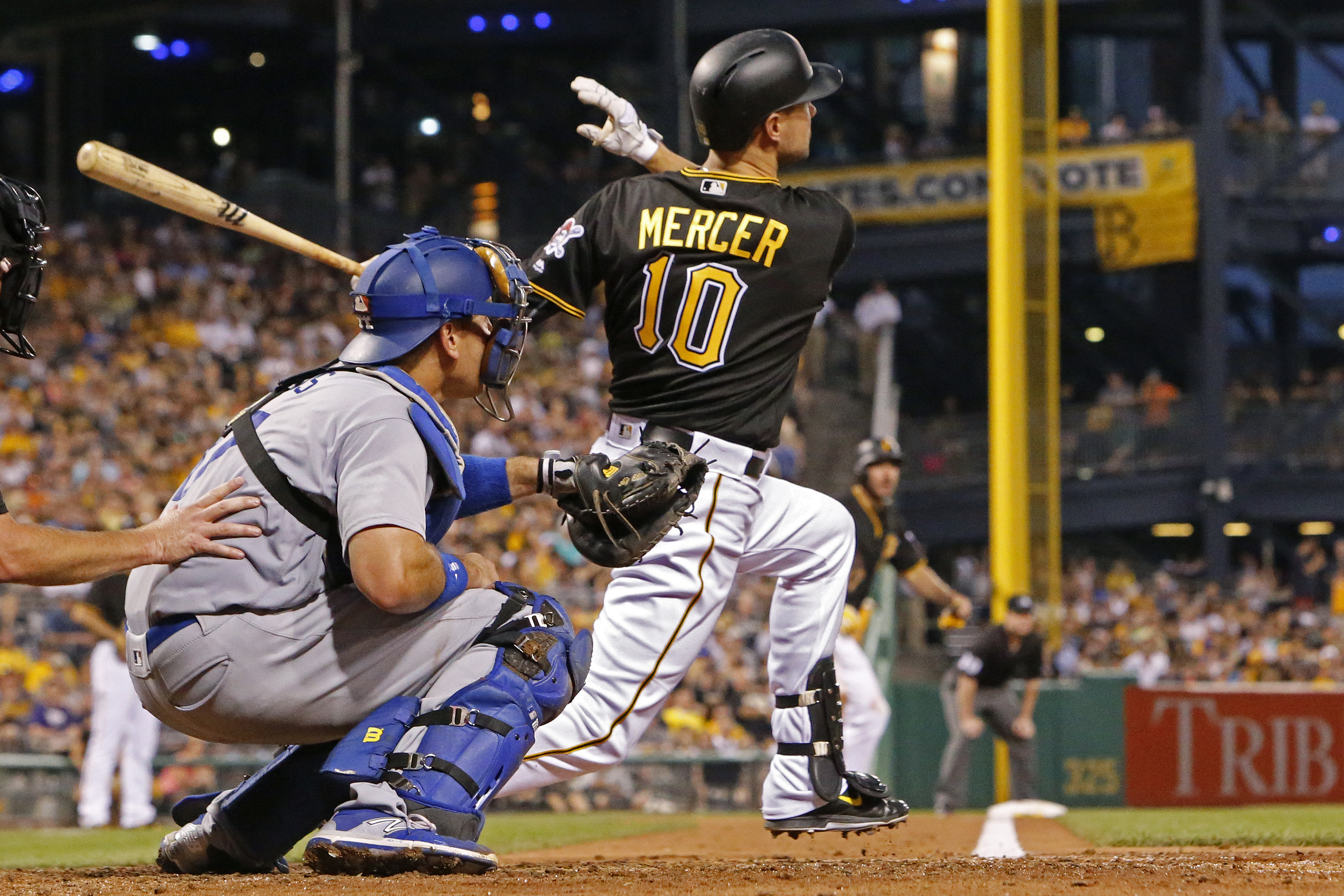 Pittsburgh Pirates' Jordy Mercer (10) hits a two-run home run off Los Angeles Dodgers relief pitcher Joe Blanton in the sixth inning of a baseball game in Pittsburgh, Saturday, June 25, 2016. (AP Photo/Gene J. Puskar)
