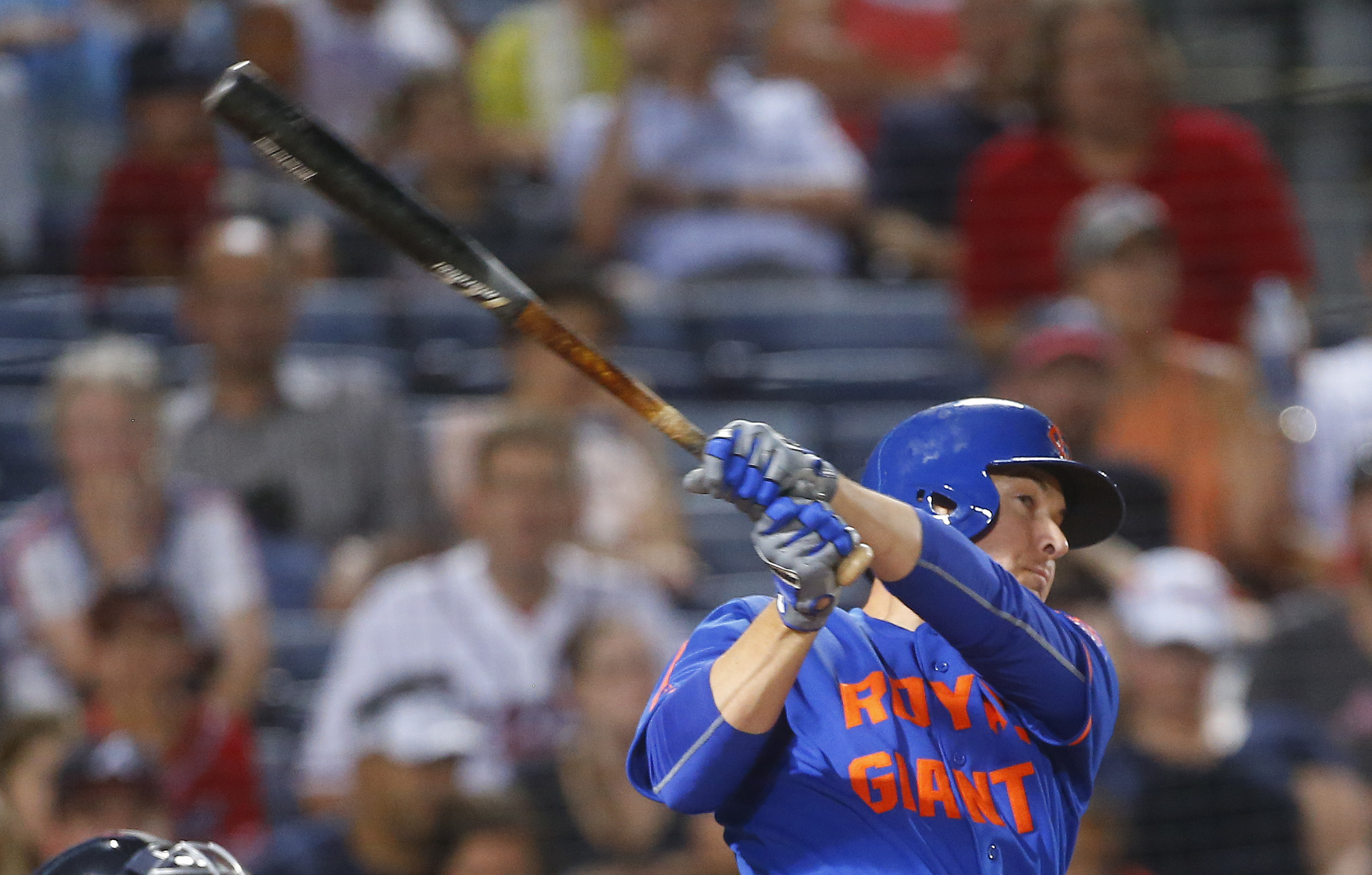 New York Mets pinch hitter Kelly Johnson follows through on a solo home run in the 11th inning of a baseball game against the Atlanta Braves, Saturday, June 25, 2016, in Atlanta. (AP Photo/John Bazemore)