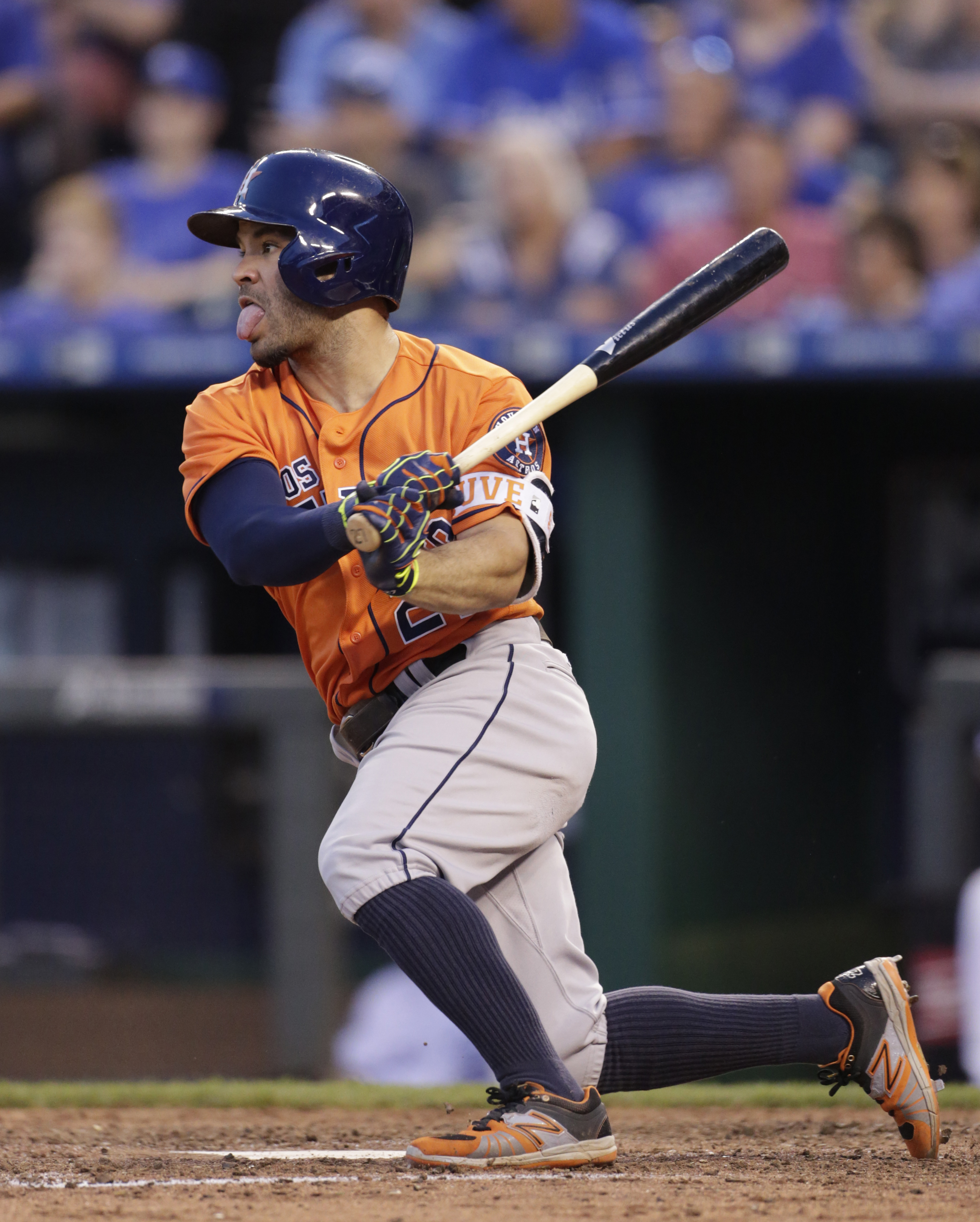 Houston Astros Jose Altuve hits a double in the sixth inning of a baseball game against the Kansas City Royals at Kauffman Stadium in Kansas City, Mo., Saturday, June 25, 2016. The Astros beat the Royals 13-5. (AP Photo/Colin E. Braley)