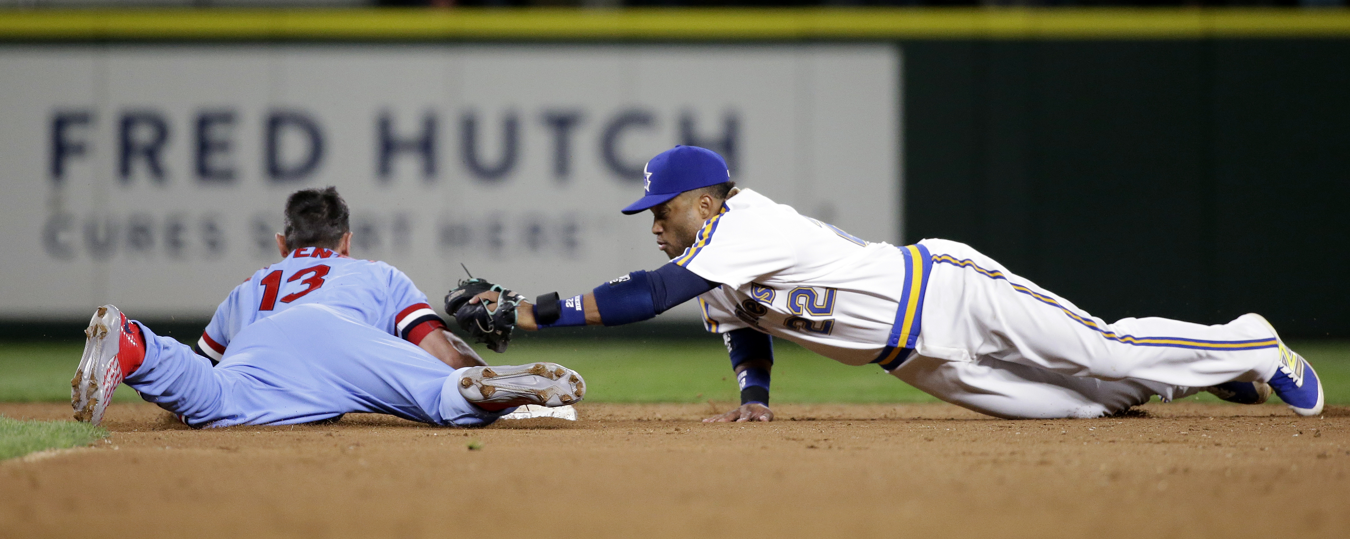 Seattle Mariners second baseman Robinson Cano (22) reaches for St. Louis Cardinals' Matt Carpenter on Carpenter's double in the ninth inning of a baseball game Saturday, June 25, 2016, in Seattle. The Mariners won 5-4. (AP Photo/Elaine Thompson)