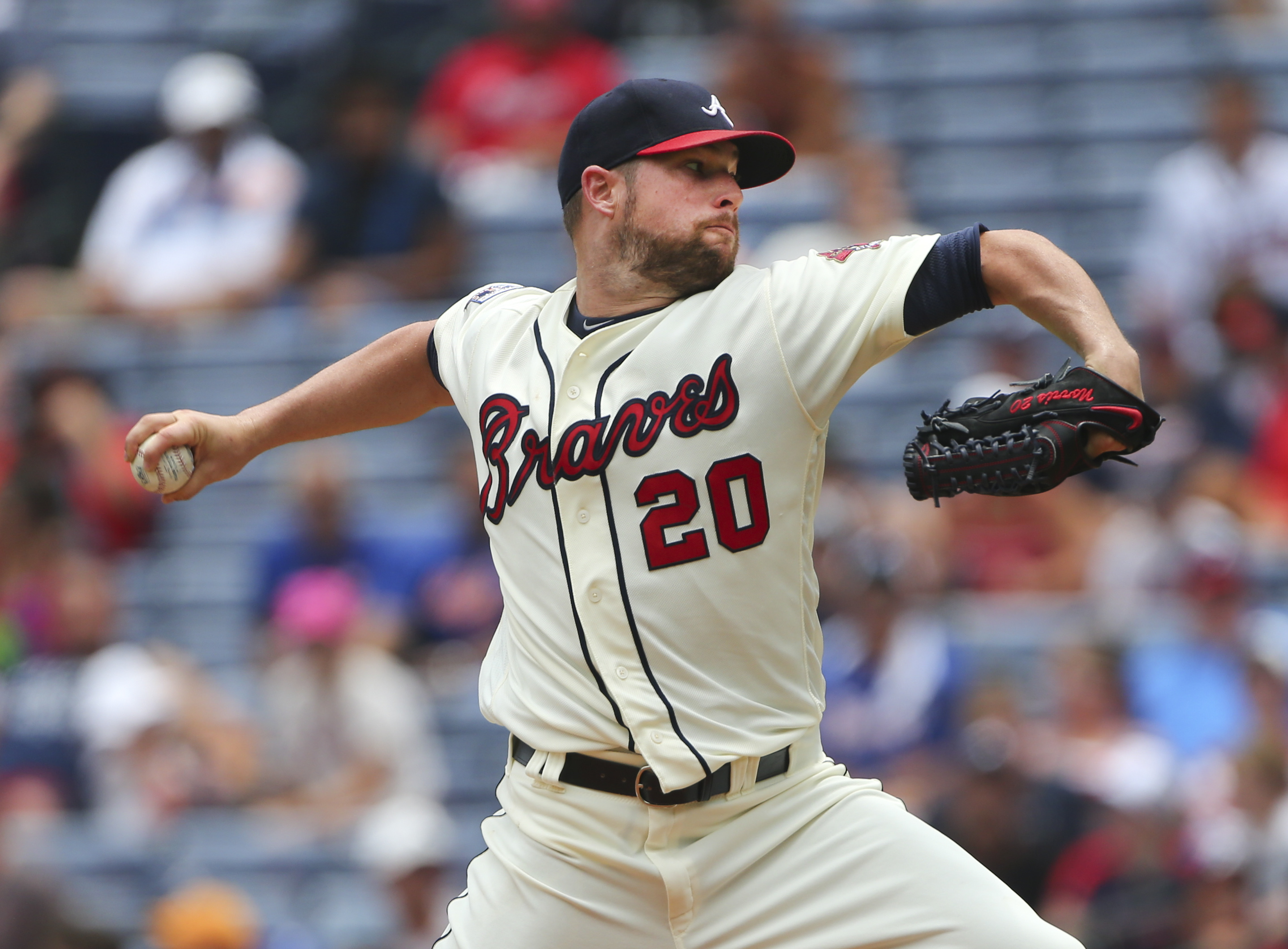 Atlanta Braves starting pitcher Bud Norris (20) delivers a pitch to a New York Mets batter in the first inning of a baseball game Sunday, June 26, 2016, in Atlanta. (AP Photo/John Bazemore)